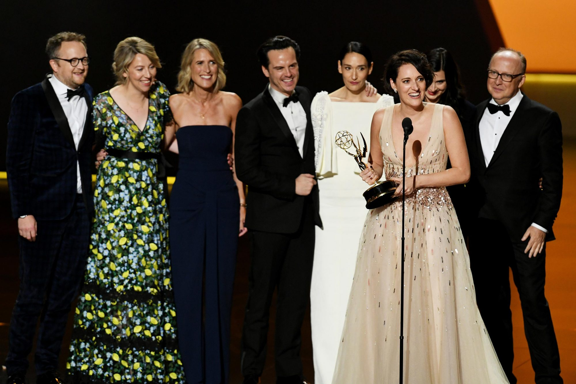 Phoebe Waller-Bridge (speaking) and fellow cast and crew members of 'Fleabag' accept the Outstanding Comedy Series award