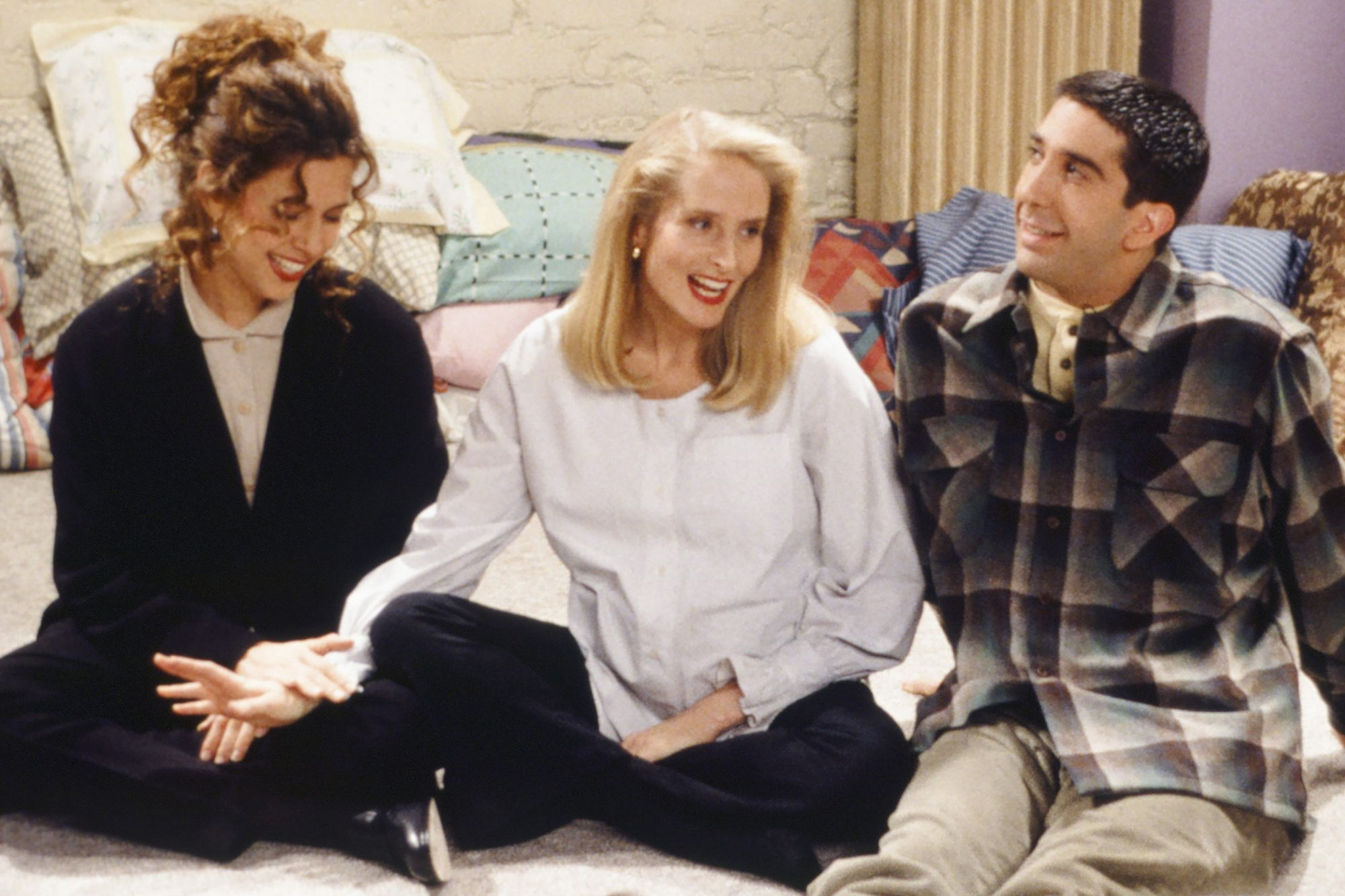 """FRIENDS -- """"The One With Two Parts: Part 1"""" Episode 116 -- Pictured: (l-r) Jessica Hecht as Susan Bunch, Jane Sibbett as Carol Willick, David Schwimmer as Ross Geller -- (Photo by: Paul Drinkwater/NBC/NBCU Photo Bank via Getty Images)"""