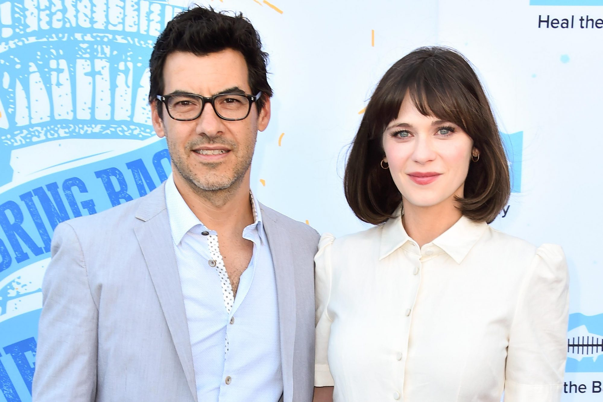 SANTA MONICA, CA - MAY 17: Producer Jacob Pechenik and actress Zooey Deschanel attend the 2018 Heal The Bay's Bring Back The Beach Awards Gala at The Jonathan Club on May 17, 2018 in Santa Monica, California. (Photo by Alberto E. Rodriguez/Getty Images)