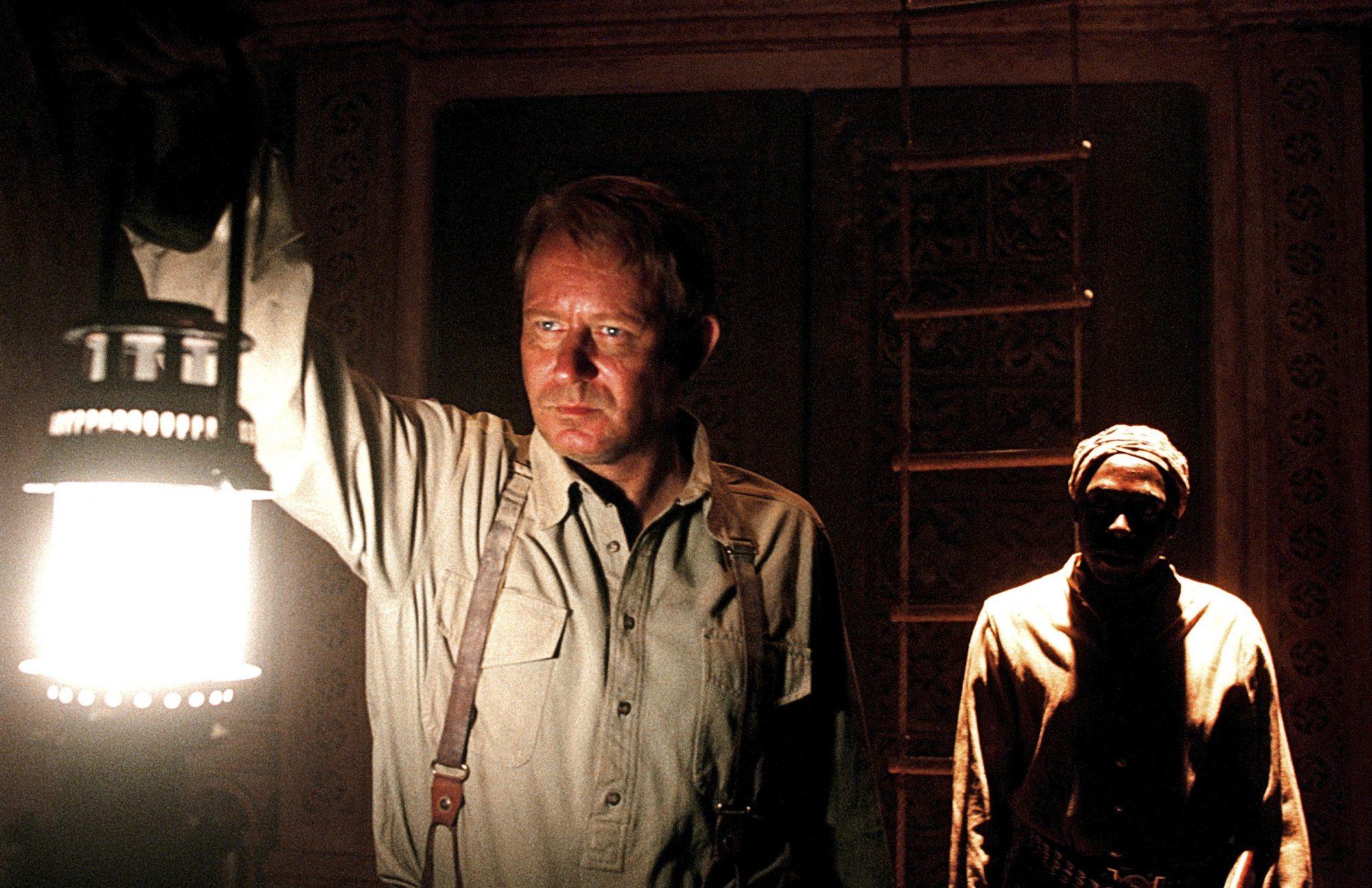 EXORCIST: THE BEGINNING, Stellan Skarsgard, Andrew French, 2004, (c) Warner Brothers/courtesy Everet