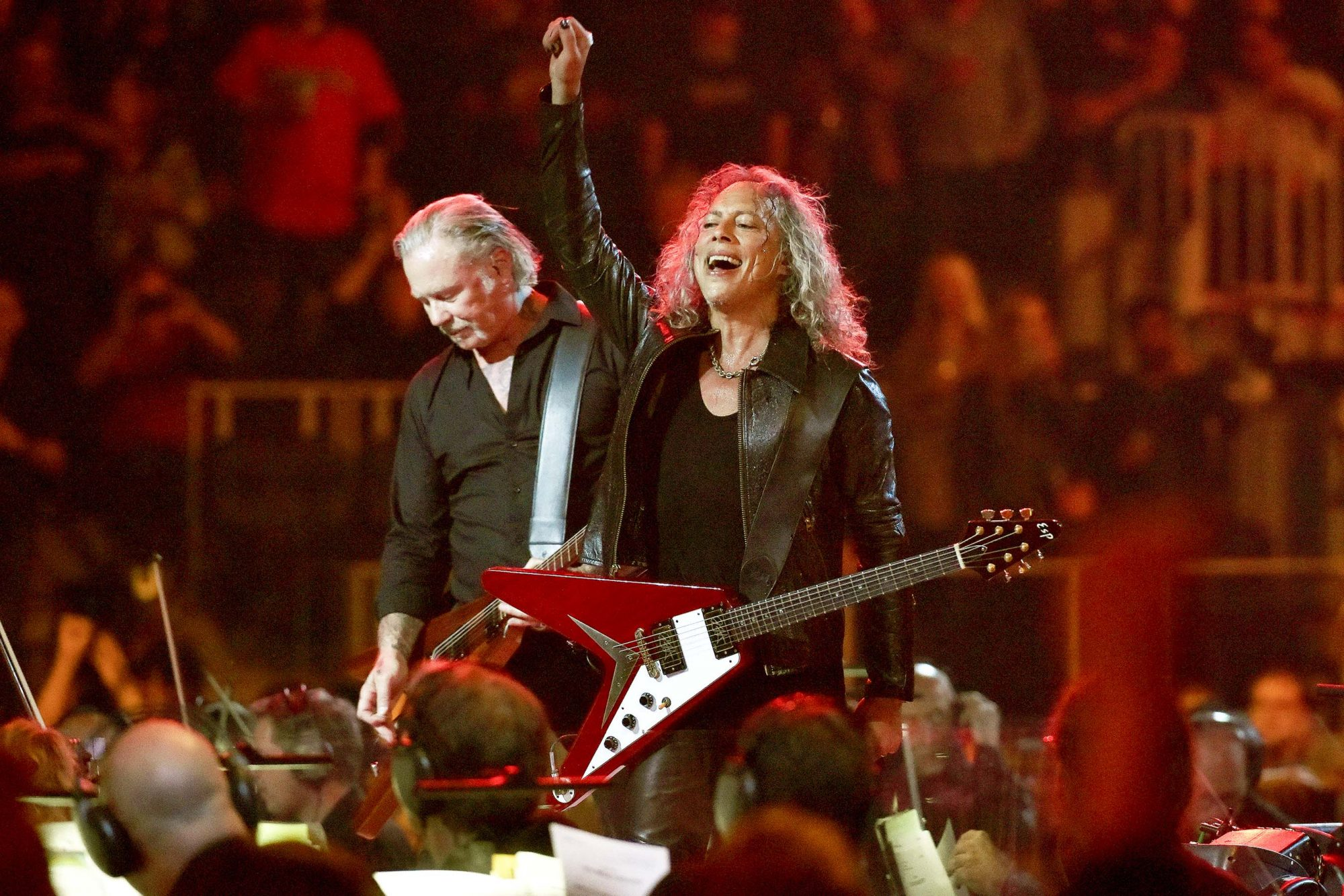"SAN FRANCISCO, CALIFORNIA - SEPTEMBER 06: James Hetfield (L) and Kirk Hammett of Metallica perform with the San Francisco Symphony during the ""S&M2"" concerts at the opening night at Chase Center on September 06, 2019 in San Francisco, California. (Photo by Tim Mosenfelder/Getty Images)"