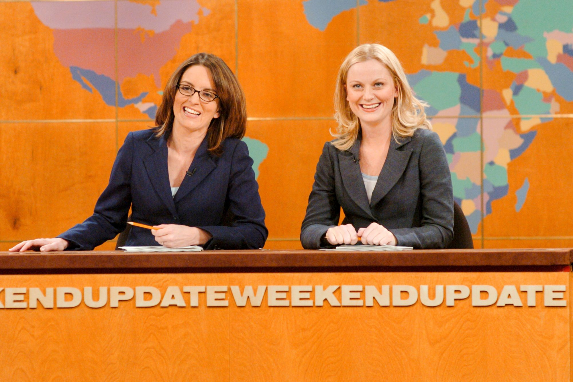 "SATURDAY NIGHT LIVE -- Episode 7 -- Aired 12/11/2004 -- Pictured: (l-r) Tina Fey, Amy Poehler during ""Weekend Update"" (Photo by Dana Edelson/NBC/NBCU Photo Bank via Getty Images)"