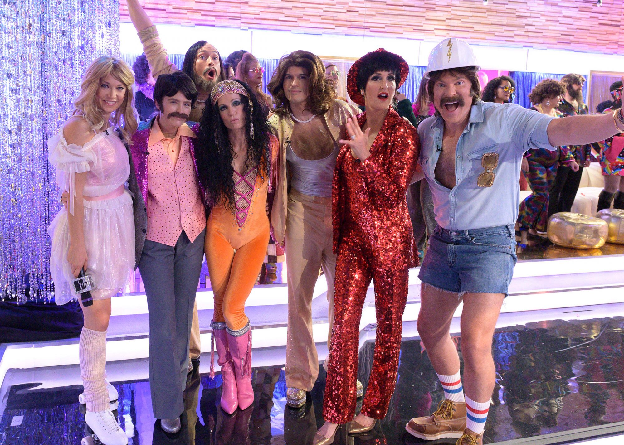 Good Morning America Halloween Robin Roberts (Donna Summer) and Michael Strahan (The Bee Gees) boogied with Lara Spencer (Liza Minnelli), Ginger Zee (Olivia Newton-John) Amy Robach (Cher), Sara Haines (Sonny), Sam Champion (The Village People), Whit Johnson and Gio Benitez (The Bee Gees)