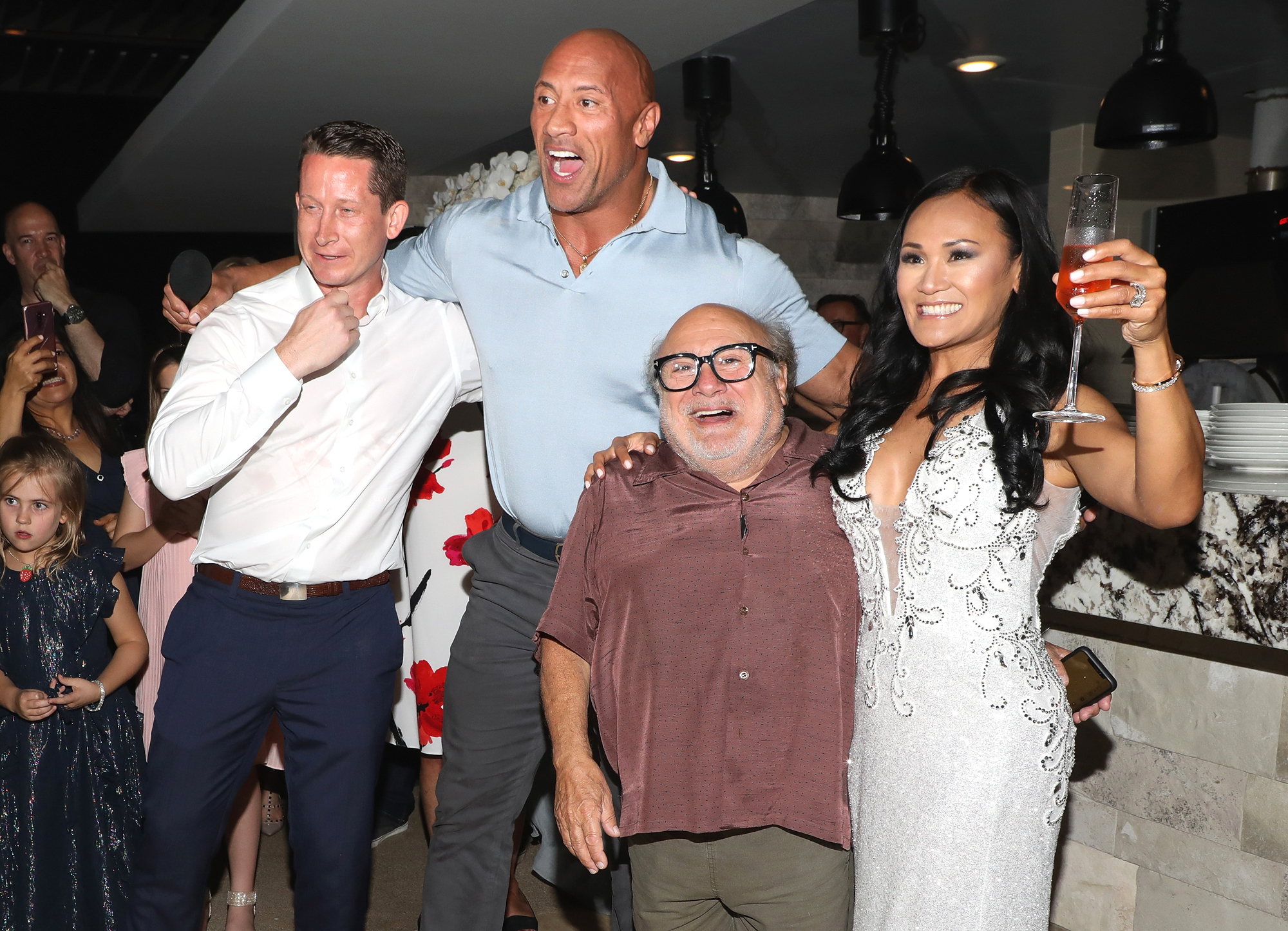 "Dwayne Johnson and Danny DeVito of ""Jumanji: The Next Level"" crash a wedding"