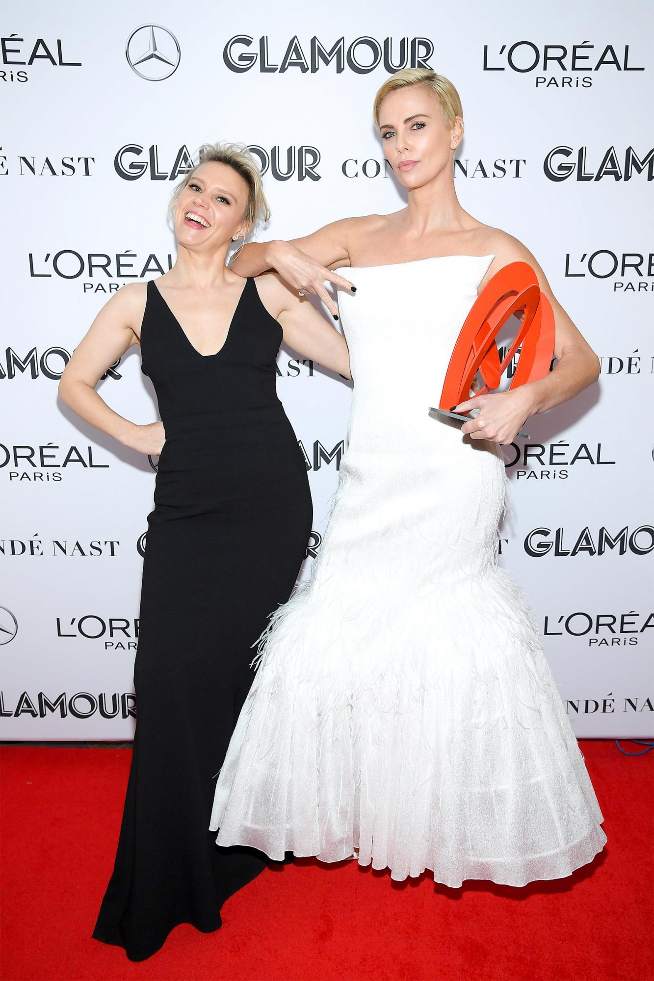 Kate McKinnon and Charlize Theron