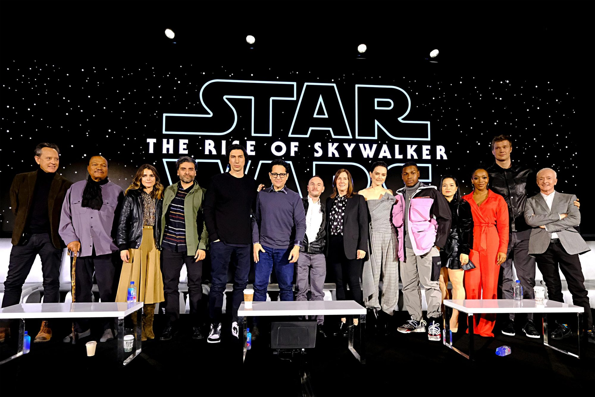 """Richard E. Grant, Billy Dee Williams, Keri Russell, Oscar Isaac, Adam Driver, Writer/director J.J. Abrams, Co-writer Chris Terrio, Producer and President of Lucasfilm Kathleen Kennedy, Daisy Ridley, John Boyega, Kelly Marie Tran, Naomi Ackie, Joonas Suotamo and Anthony Daniels participate in the global press conference for """"Star Wars: The Rise of Skywalker"""""""