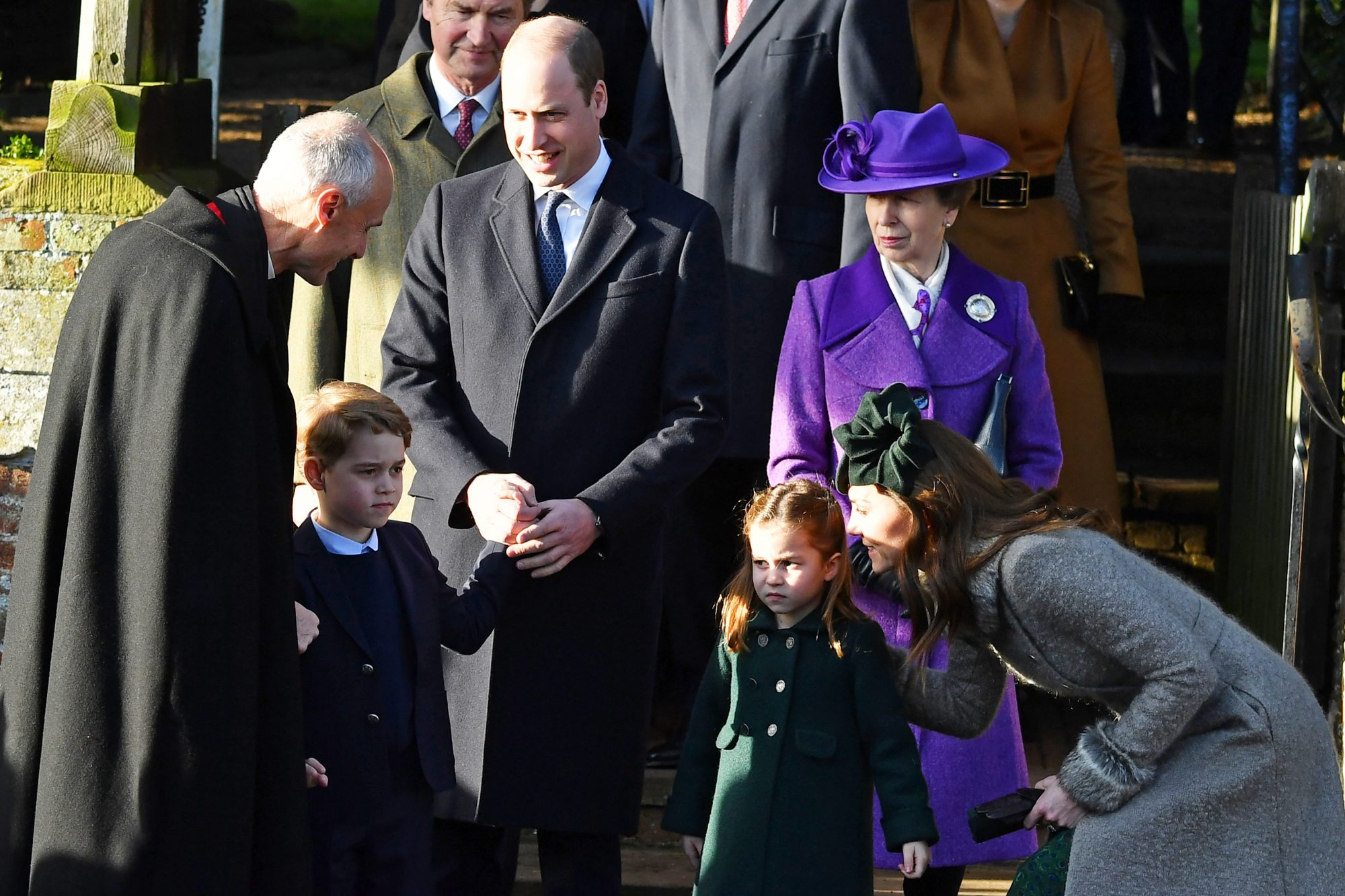 (L-R) Britain's Prince George of Cambridge, Britain's Prince William, Duke of Cambridge, Britain's Princess Charlotte of Cambridge, Britain's Princess Anne, Princess Royal and Britain's Catherine, Duchess of Cambridge leave after the Royal Family's traditional Christmas Day service at St Mary Magdalene Church in Sandringham, Norfolk, eastern England, on December 25, 2019. (Photo by Ben STANSALL / AFP) (Photo by BEN STANSALL/AFP via Getty Images)