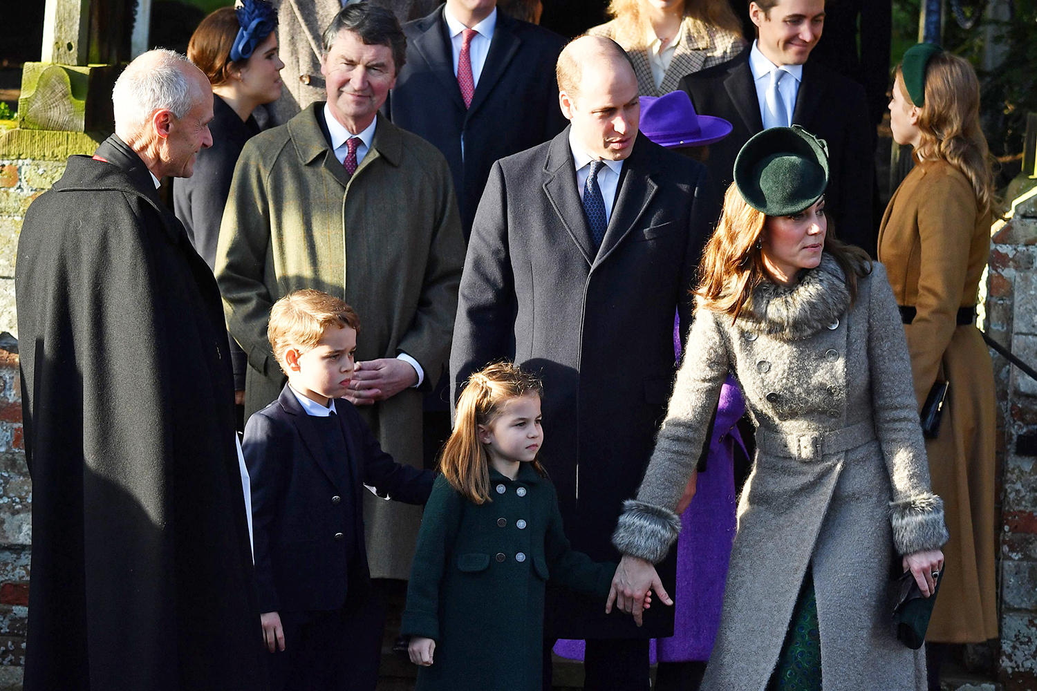 (L-R) Britain's Prince George of Cambridge, Britain's Princess Charlotte of Cambridge, Britain's Prince William, Duke of Cambridge and Britain's Catherine, Duchess of Cambridge leave after the Royal Family's traditional Christmas Day service at St Mary Magdalene Church in Sandringham, Norfolk, eastern England, on December 25, 2019. (Photo by Ben STANSALL / AFP) (Photo by BEN STANSALL/AFP via Getty Images)