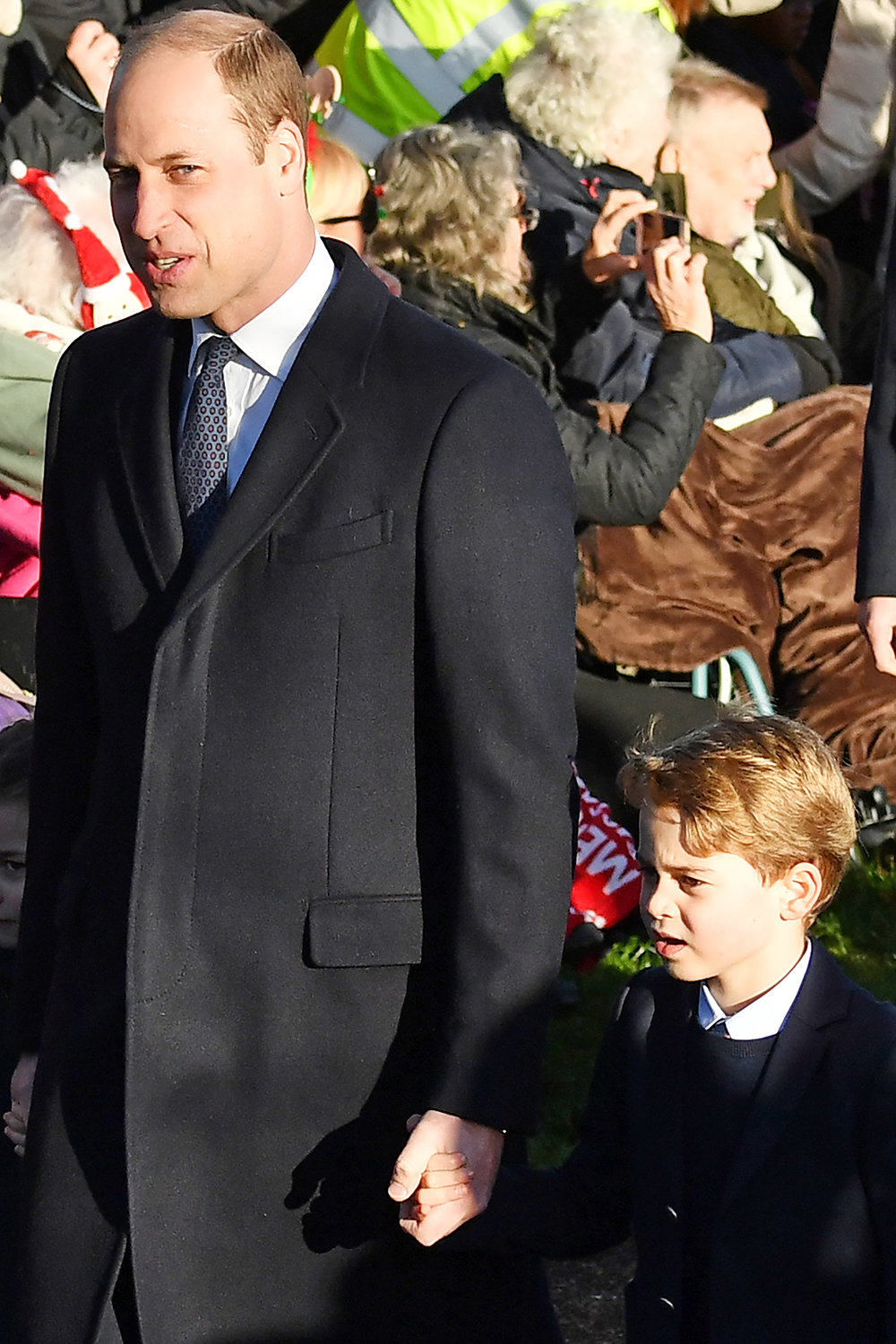 Britain's Prince William, Duke of Cambridge (L) and Britain's Prince George of Cambridge arrive for the Royal Family's traditional Christmas Day service at St Mary Magdalene Church in Sandringham, Norfolk, eastern England, on December 25, 2019. (Photo by Ben STANSALL / AFP) (Photo by BEN STANSALL/AFP via Getty Images)