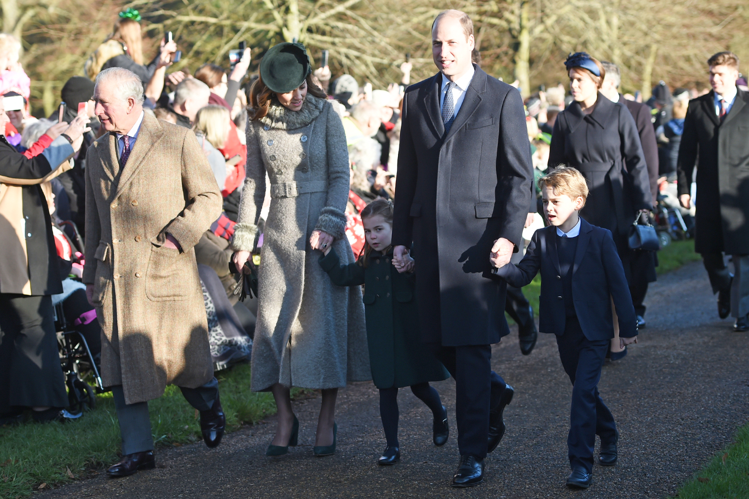 The Prince of Wales with the Duke and Duchess of Cambridge and their children Prince George and Princess Charlotte arriving to attend the Christmas Day morning church service
