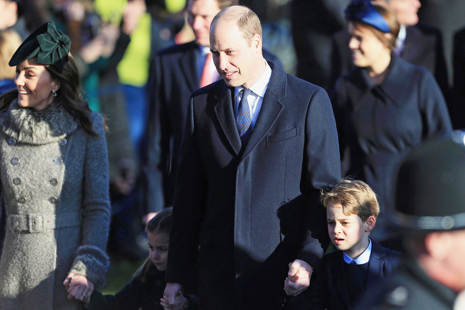 Prince William, Duke of Cambridge, Catherine, Duchess of Cambridge and Prince George attend the Christmas Day Church service