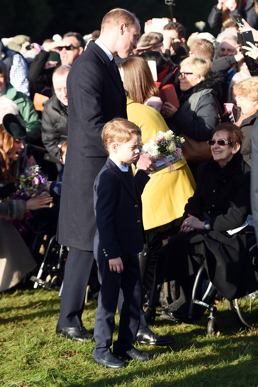 The Duke of Cambridge and Prince George meet well wishers after attending the Christmas Day morning church service at St Mary Magdalene Church in Sandringham, Norfolk. (Photo by Joe Giddens/PA Images via Getty Images)