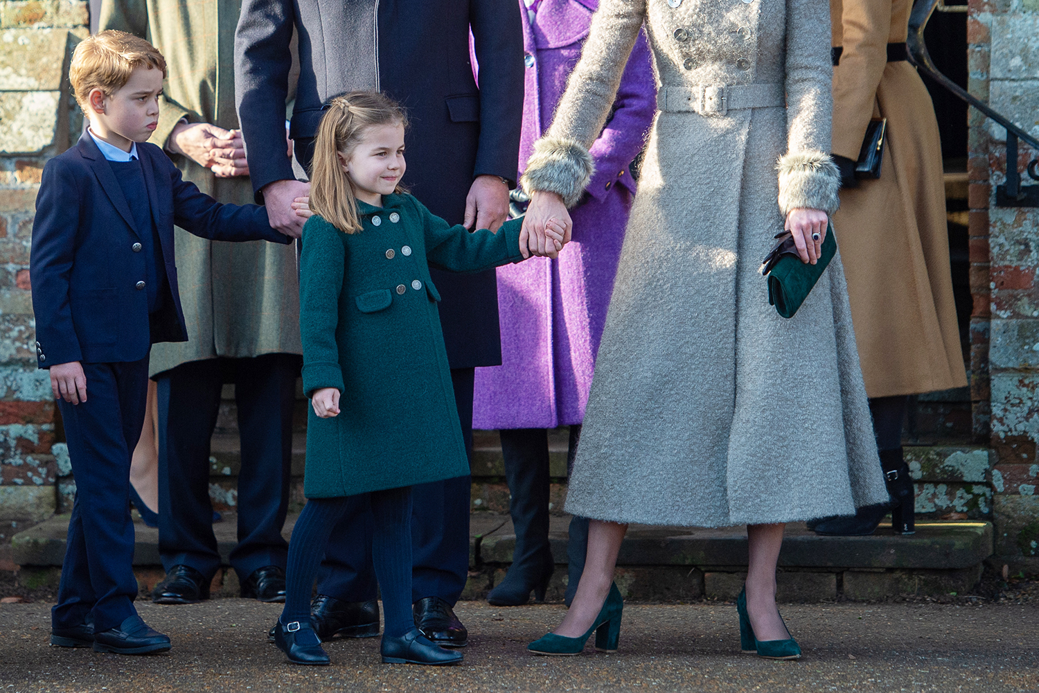 Prince George and Princess Charlotte after attending the Christmas Day morning church service at St Mary Magdalene Church in Sandringham, Norfolk. (Photo by Joe Giddens/PA Images via Getty Images)