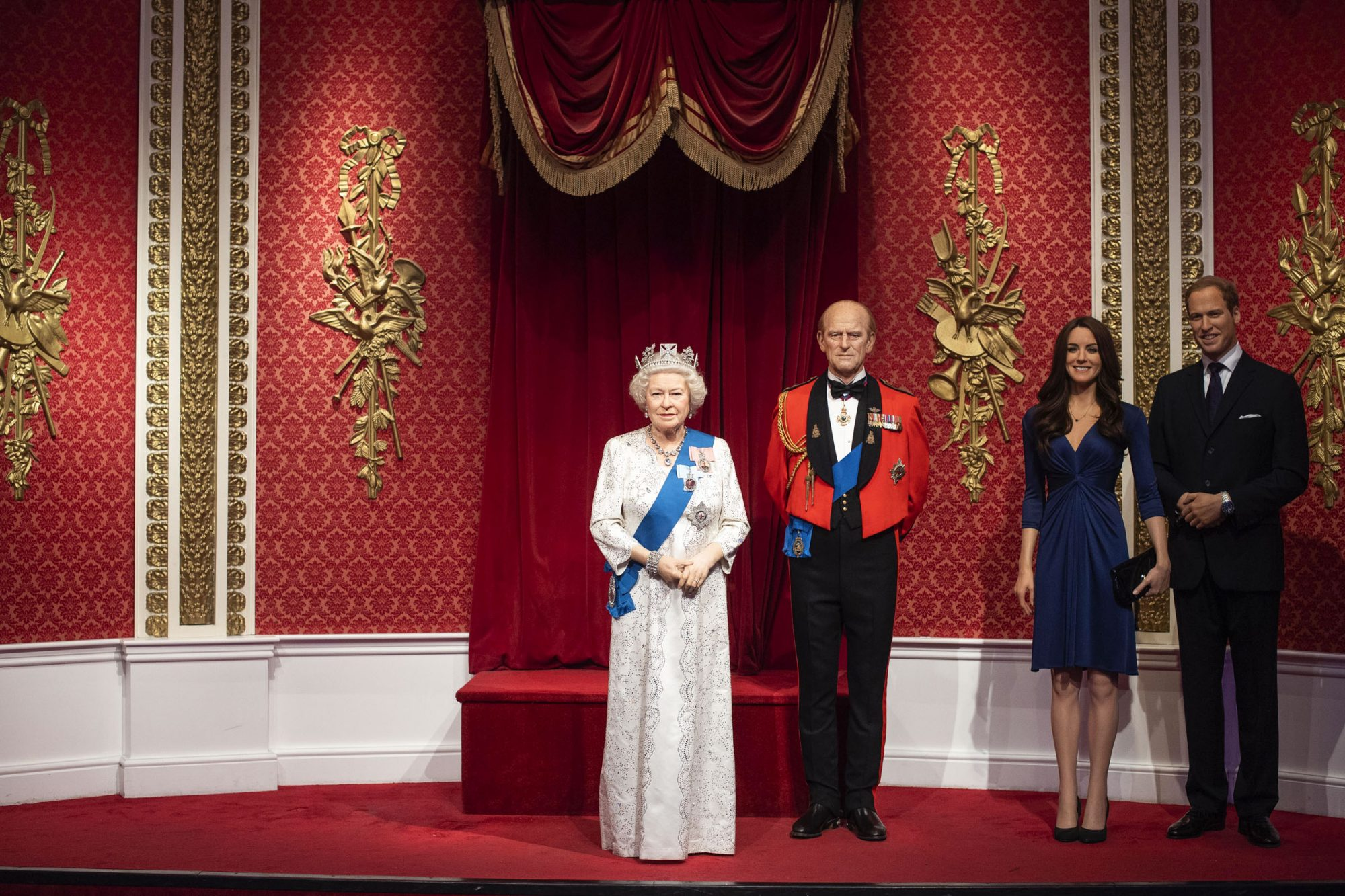 The empty space left next to the figures of Queen Elizabeth II, the Duke of Edinburgh, and the Duke and Duchess of Cambridge