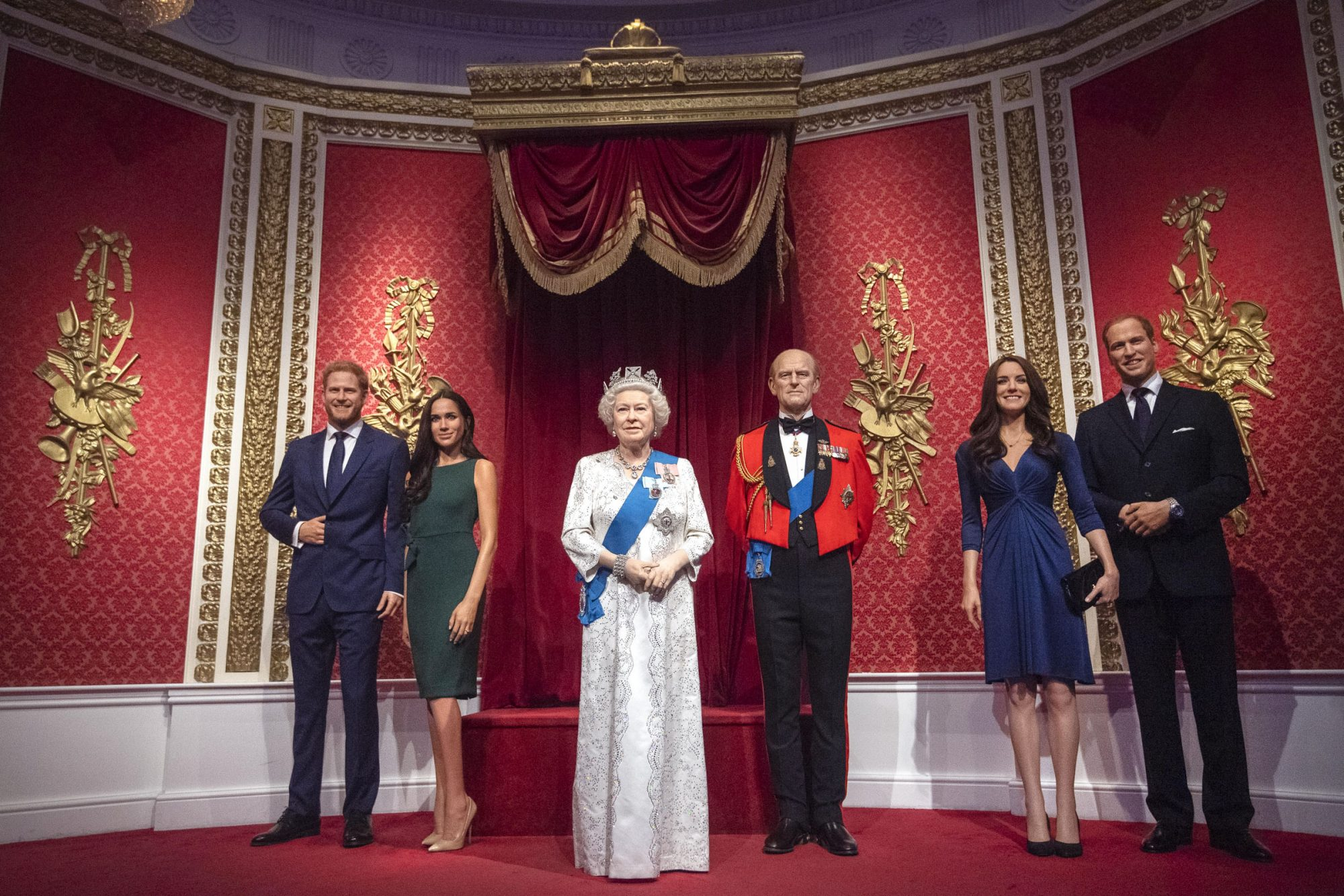 The figures of the Duke and Duchess of Sussex in their original positions next to Queen Elizabeth II, the Duke of Edinburgh, and the Duke and Duchess of Cambridg