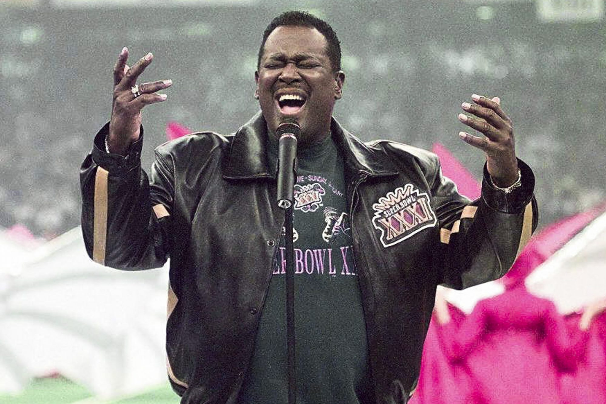 Singer Luther Vandross sings the US National Anthe
