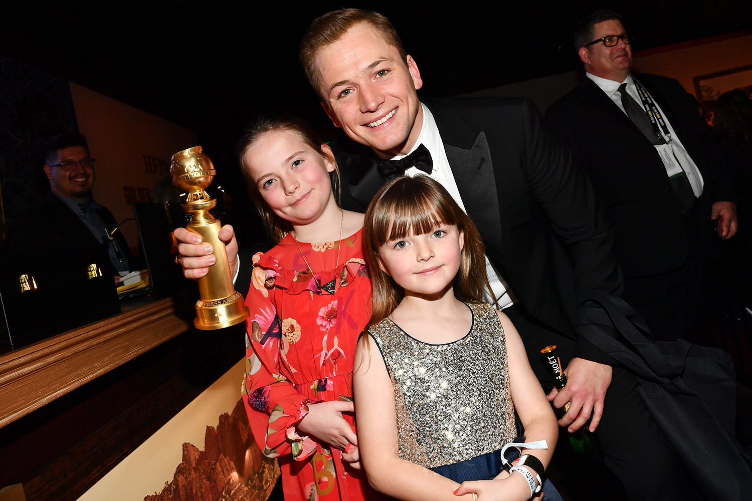 Taron Egerton with sisters Mary and Rosie