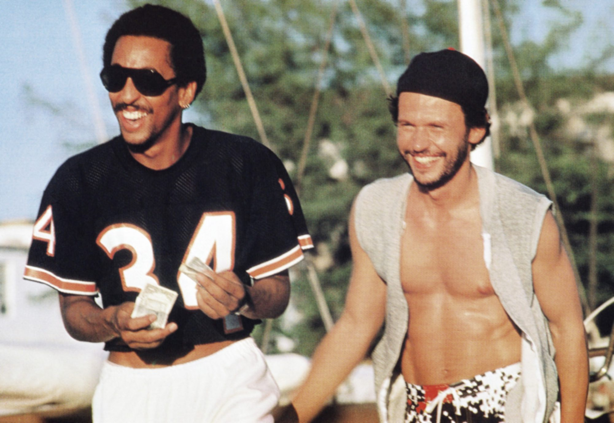 RUNNING SCARED, from left: Gregory Hines, Billy Crystal, 1986, © MGM/courtesy Everett Collection