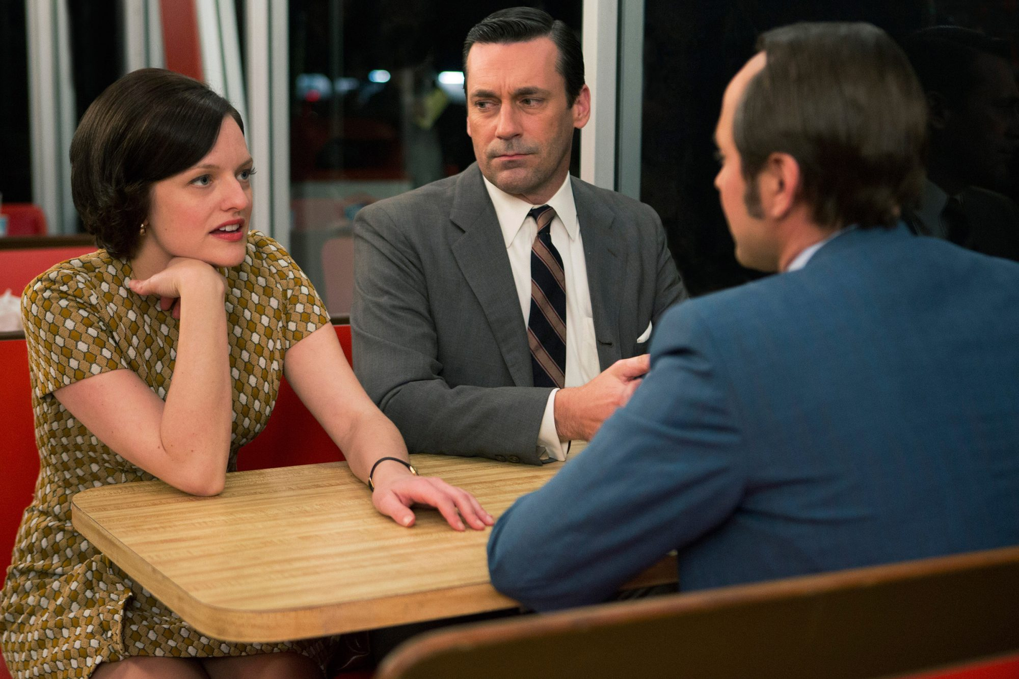 MAD MEN, (from left): Elisabeth Moss, Jon Hamm, Vincent Kartheiser (back to camera), 'The