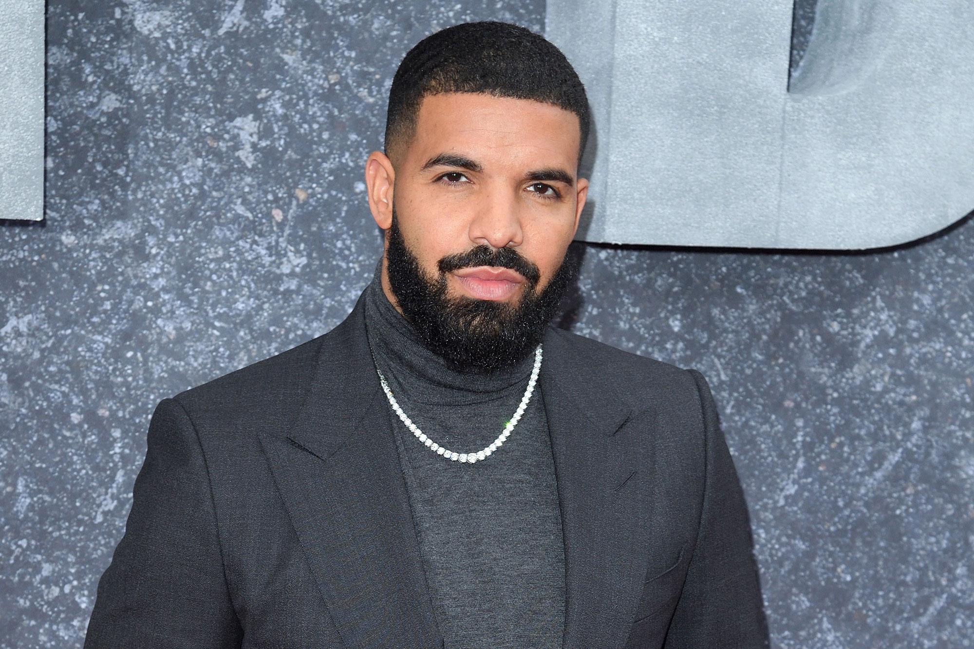Drake shares photos of son Adonis alongside message to fans | EW.com