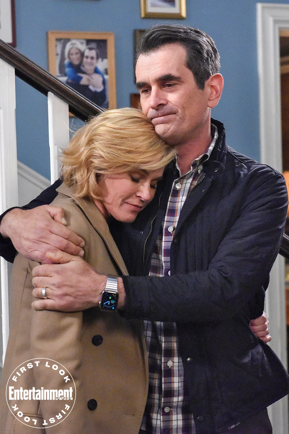Phil (Ty Burrell) comforts Claire (Julie Bowen) in the face of change