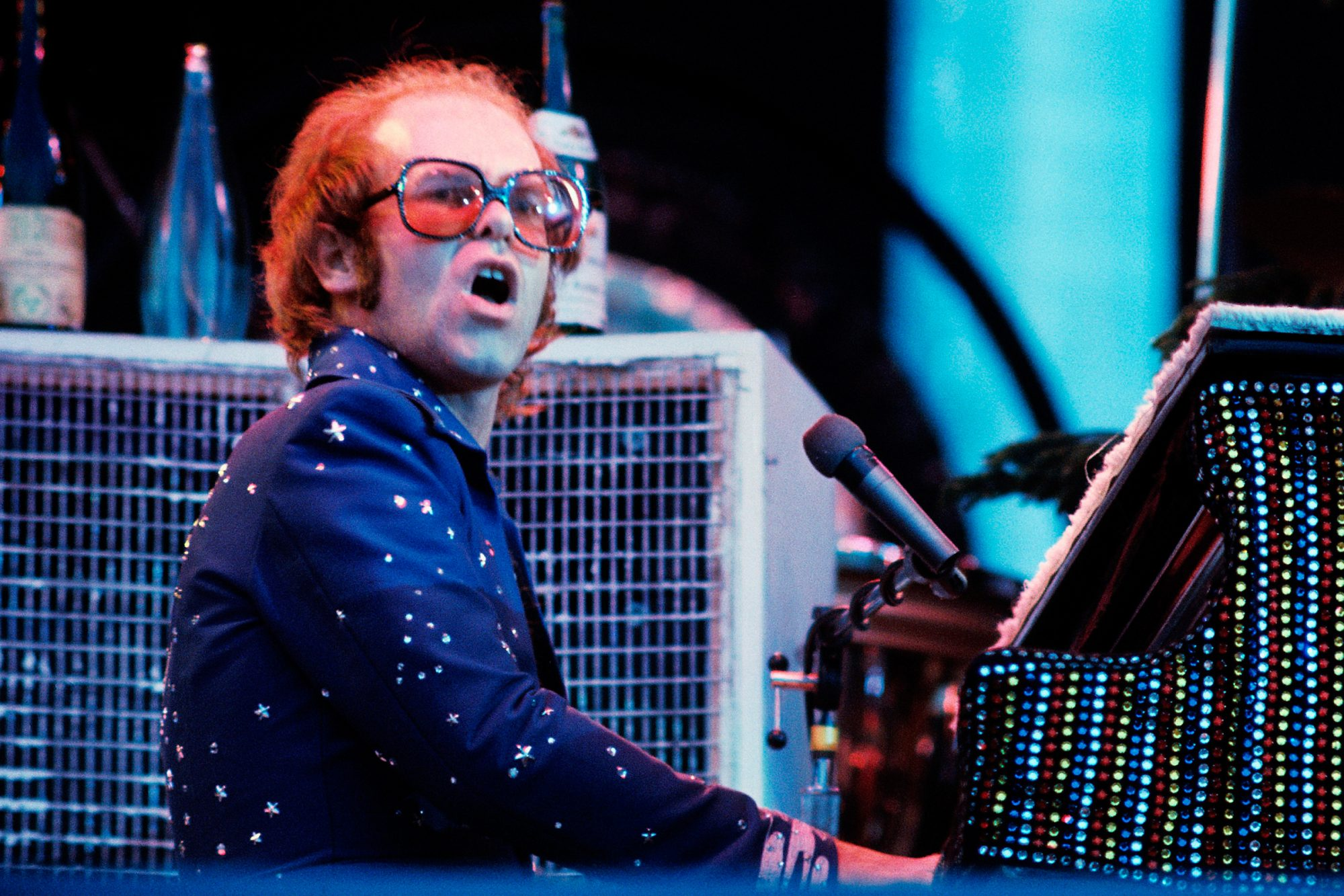 Elton John performs in concert at Wembley in 1976 in London, England