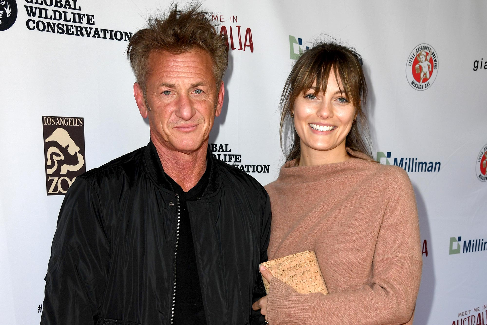 Sean Penn (L) and Leila George