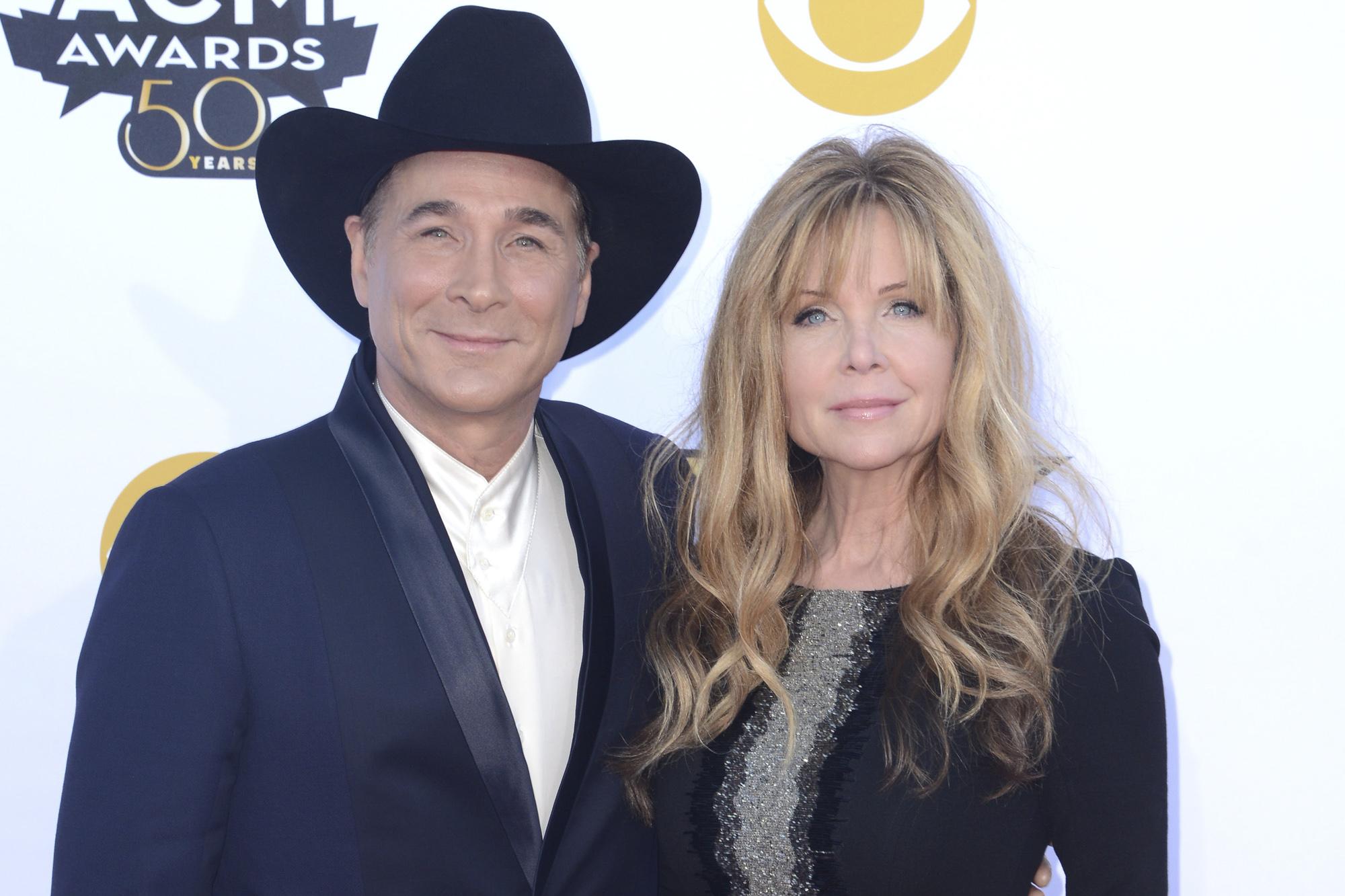 Clint Black (L) and Lisa Hartman Black