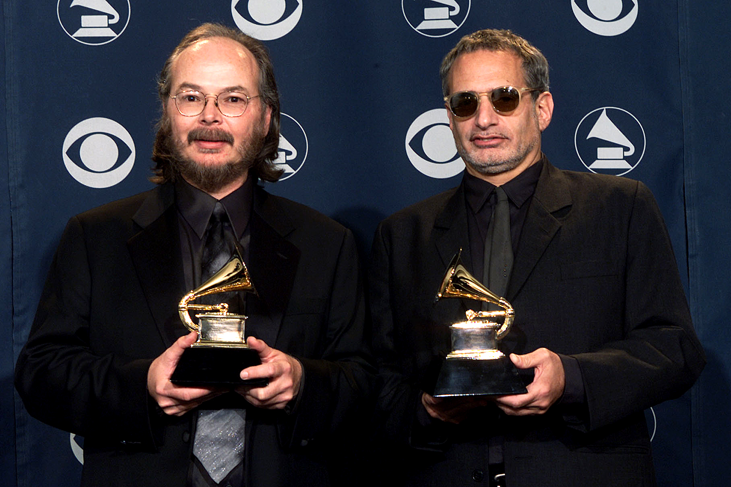 Steely Dan pose backstage with Grammy they won for Best Pop Vocal Album at the 43rd Annual Grammy Awards