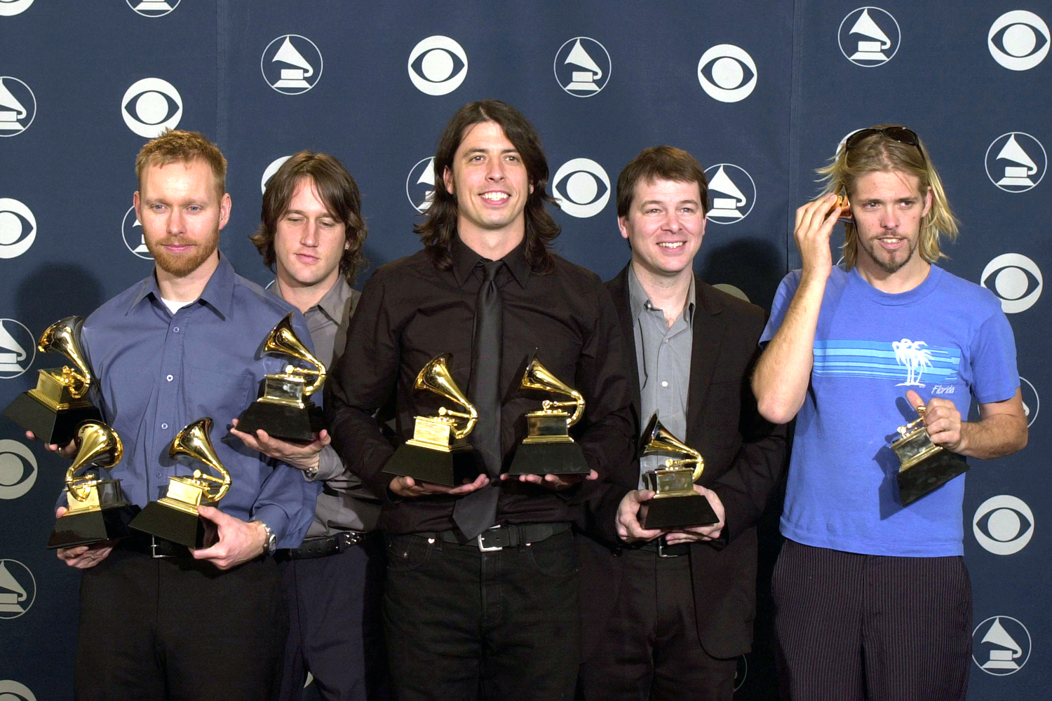 The Foo Fighters pose with their awards backstage at the 43rd Annual Grammy Awards