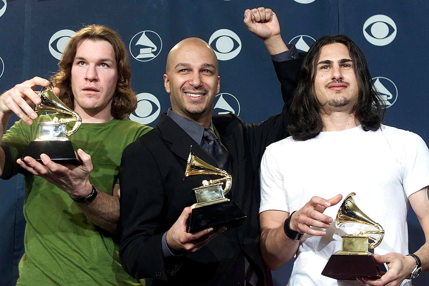 Rage Against the Machine poses with Grammy Awards