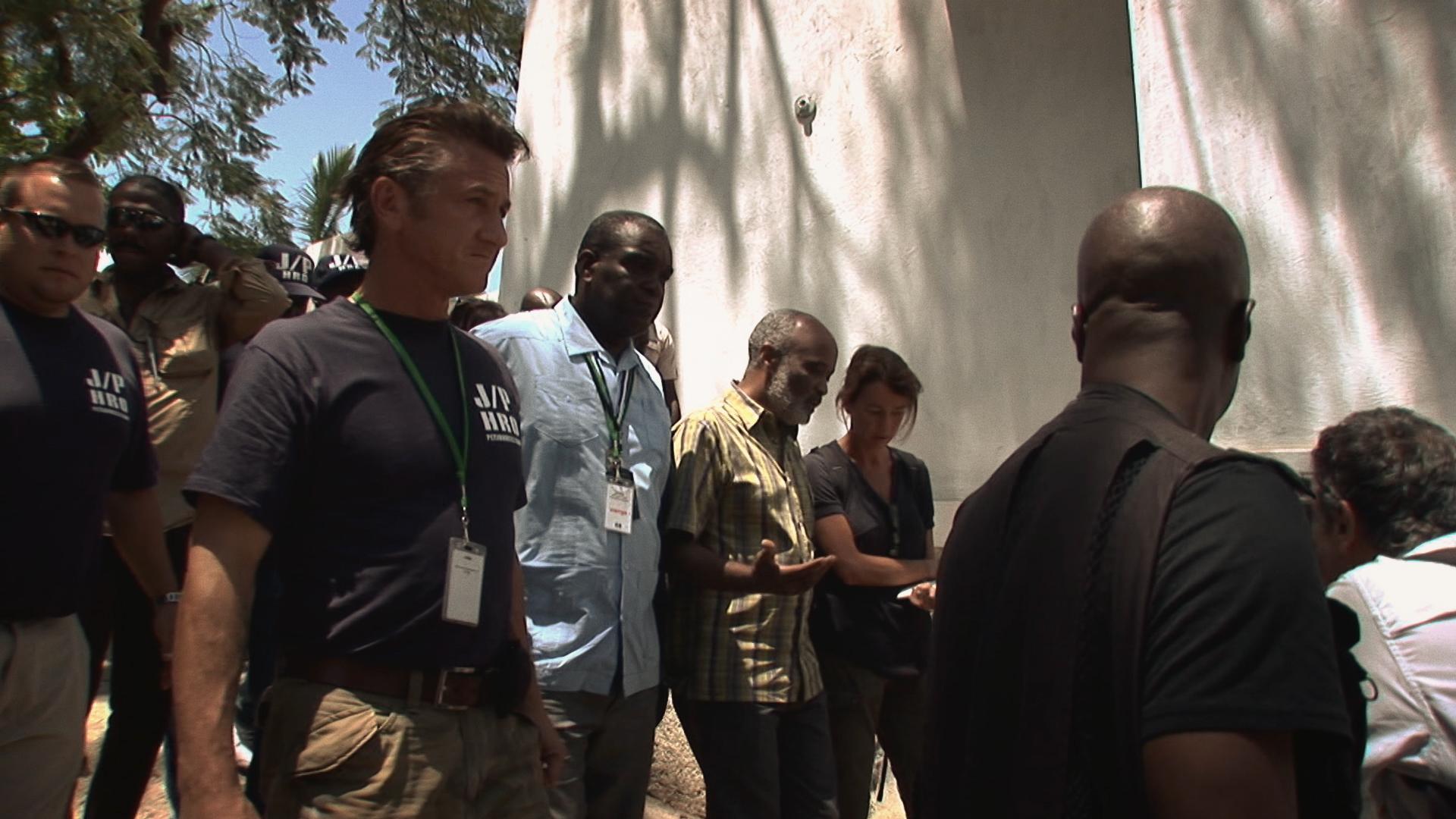 Sean Penn with former president of Haiti