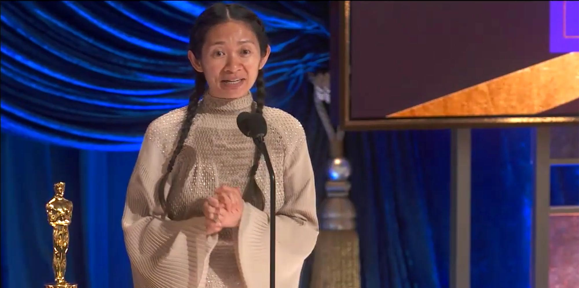 Chloe Zhao wins Best Director at the 2021 Oscars.