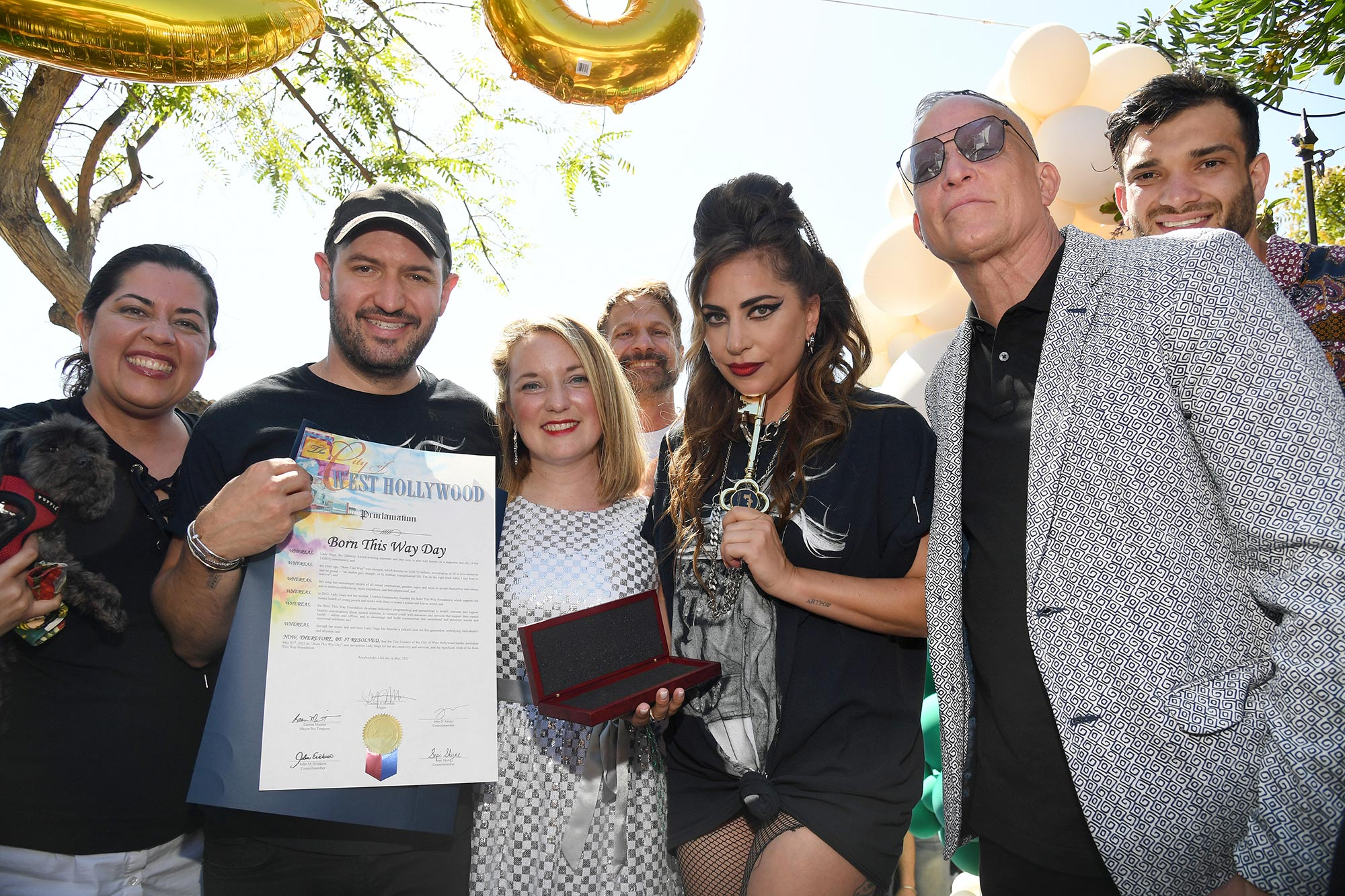 """Bobby Campbell, City of West Hollywood Mayor Lindsey P. Horvath, Lady Gaga and David Cooley pose on stage as """"Born This Way Day"""""""