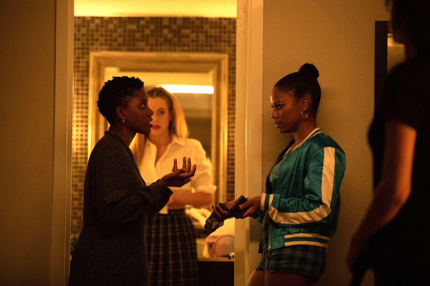 Director Janicza Bravo, actor Riley Keough and actor Taylour Paige on the set of ZOLA