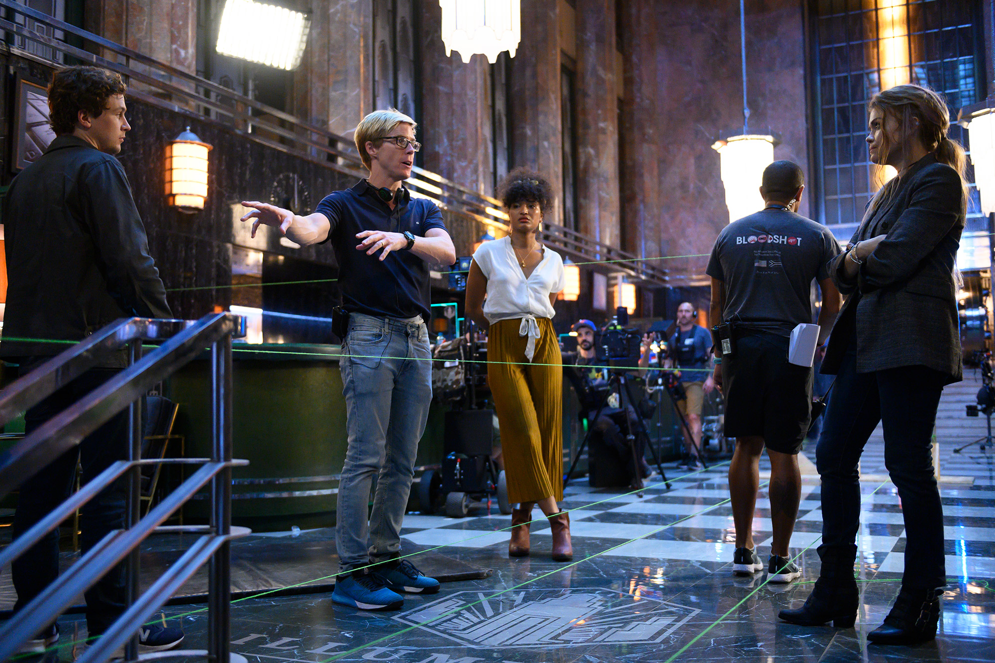 Director Adam Robitel with the cast on the set of Columbia Pictures' ESCAPE ROOM: TOURNAMENT OF CHAMPIONS.