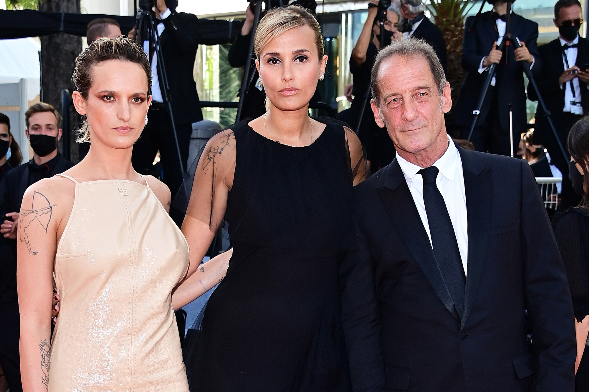 """Agathe Rousselle, Julia Ducournau and Vincent Lindon attend the final screening of """"OSS 117: From Africa With Love"""" and closing ceremony during the 74th annual Cannes Film Festival on July 17, 2021 in Cannes, France."""