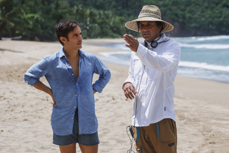 Gael García Bernal and filmmaker M. Night Shyamalan on the set of Old