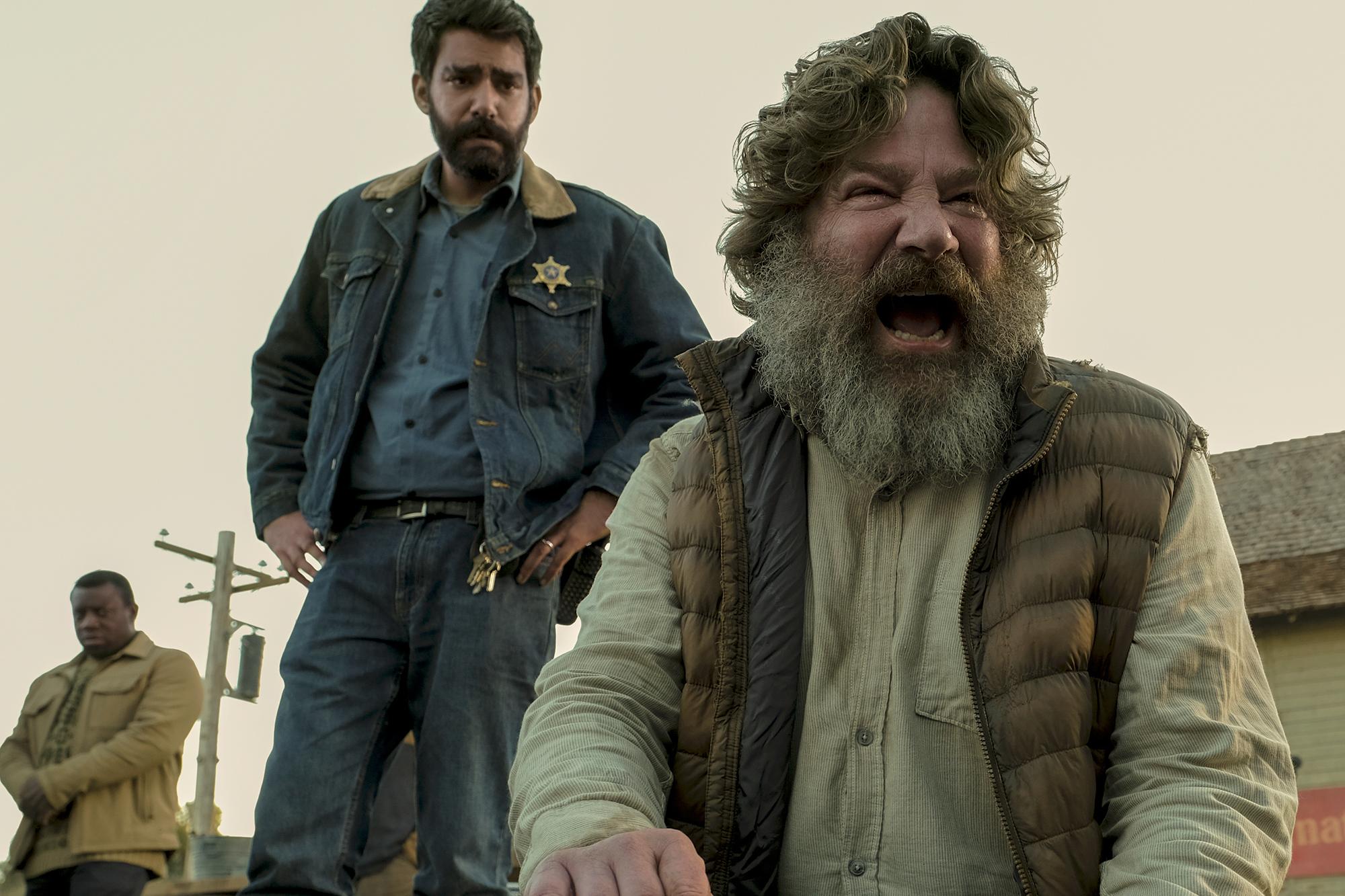 MIDNIGHT MASS (L to R) RAHUL KOHLI as SHERIFF HASSAN and MATT BIEDEL as STURGE in episode 102 of MIDNIGHT MASS