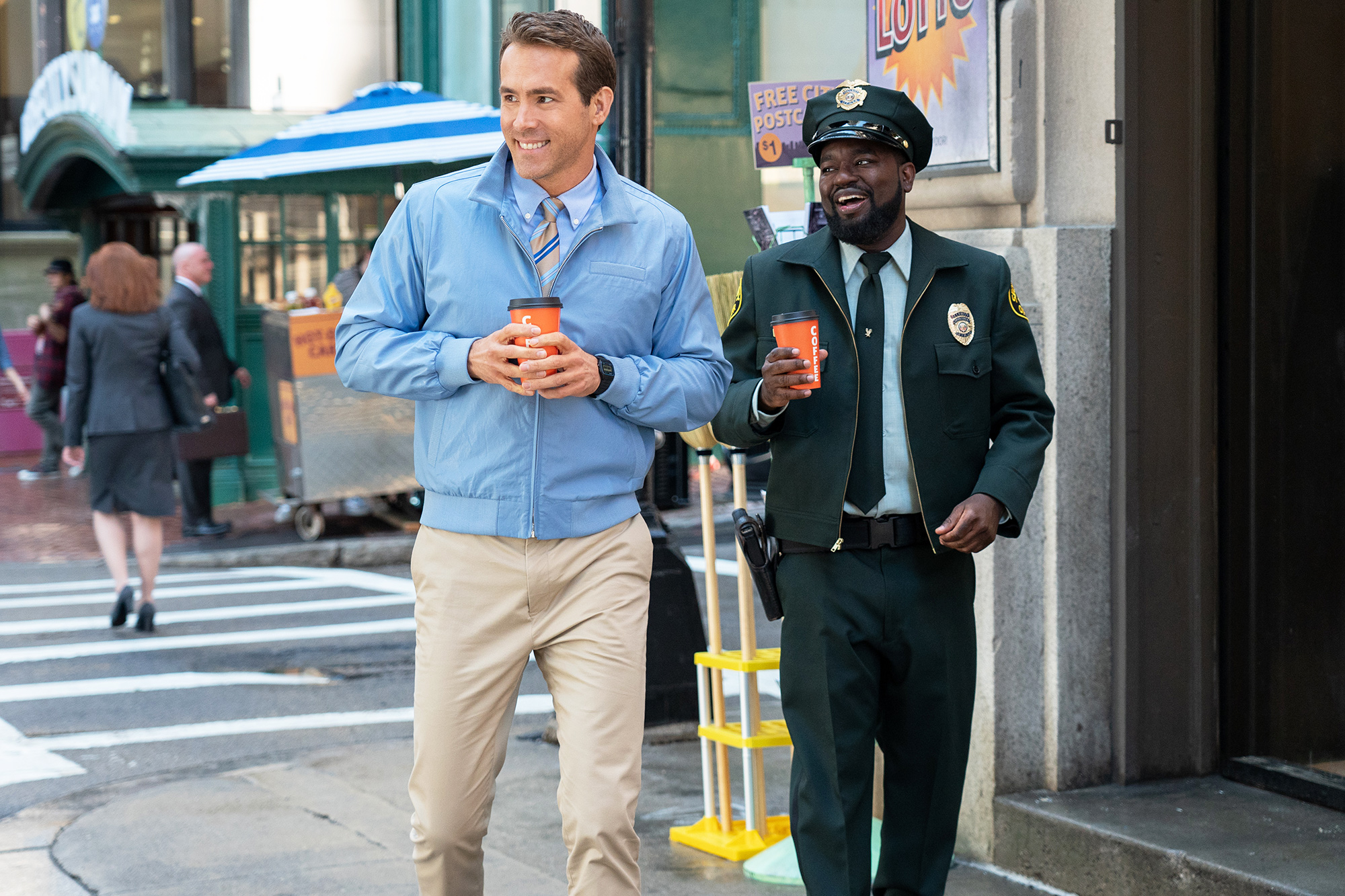 Ryan Reynolds as Guy and Lil Rel Howery as Buddy in 20th Century Studios' FREE GUY.