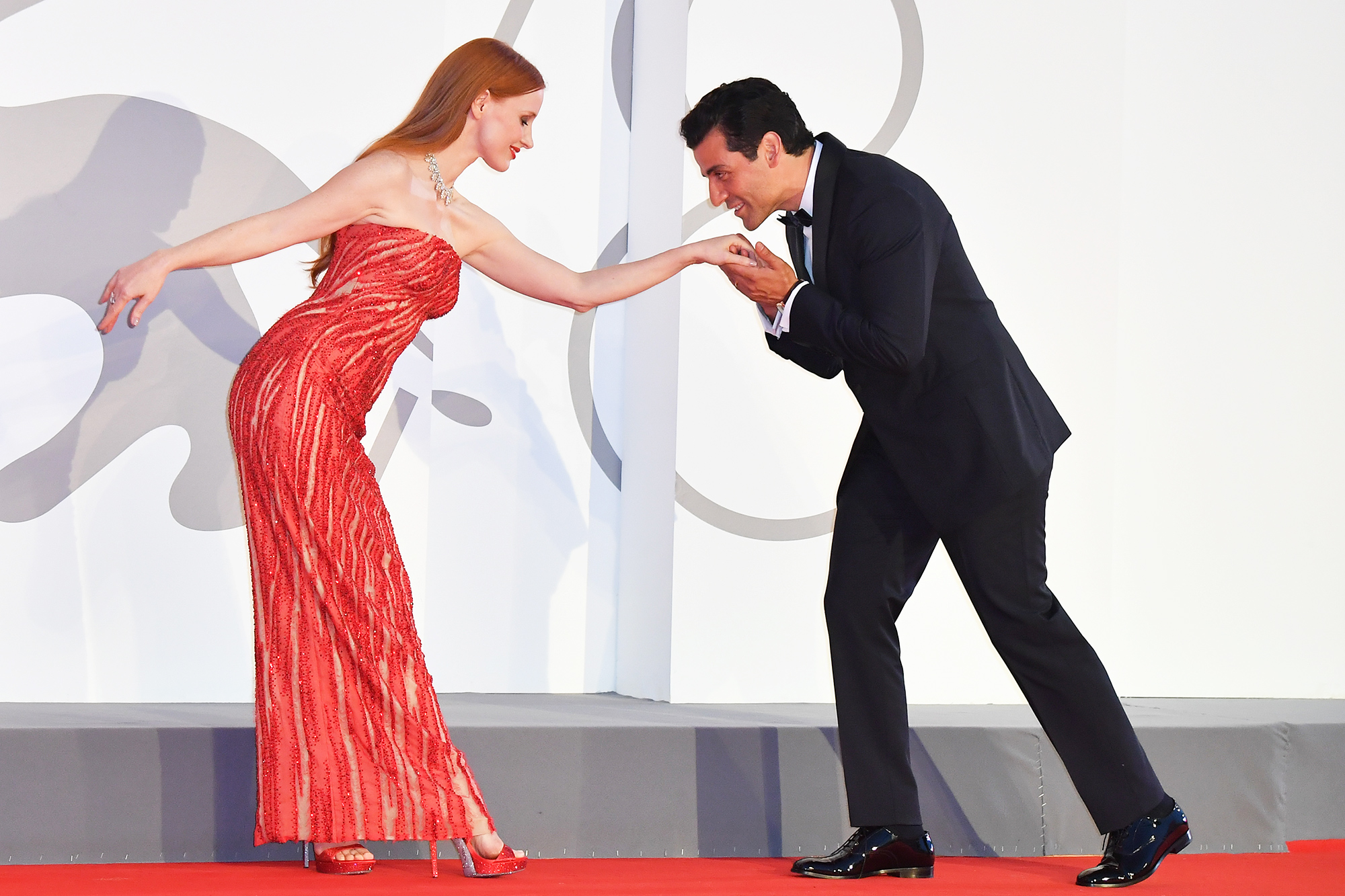 """Jessica Chastain and Oscar Isaac attend the red carpet of the movie """"Scenes From a Marriage (Ep. 1 and 2)"""" during the 78th Venice International Film Festival on September 04, 2021 in Venice, Italy."""