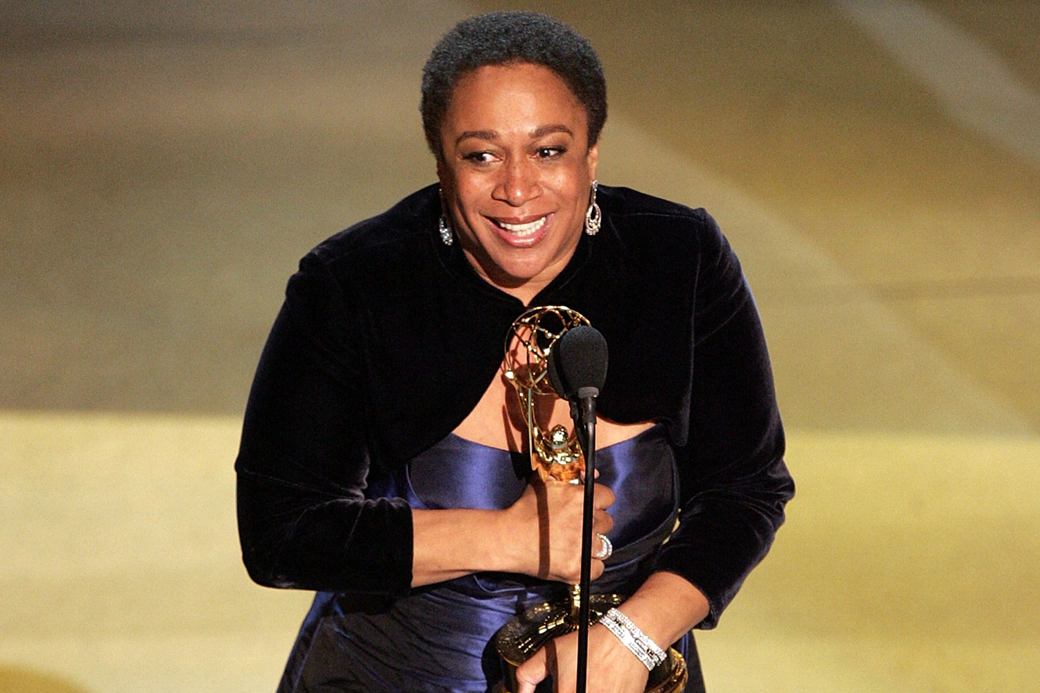 """Epatha Merkerson accepts her award for """"Outstanding Actress in a Miniseries or Movie"""" onstage at the 57th Annual Emmy Awards"""