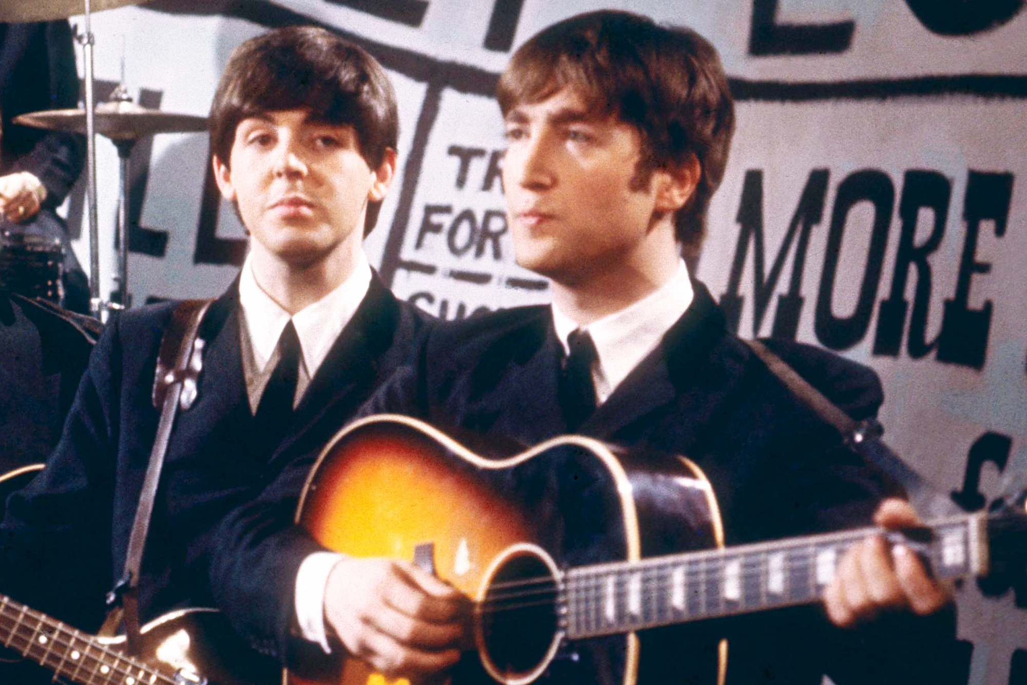 Paul McCartney and John Lennon of the The Beatles perform on Granada Television's Late Scene Extra programme at Granada television studios in Manchester, England on November 25th 1963.