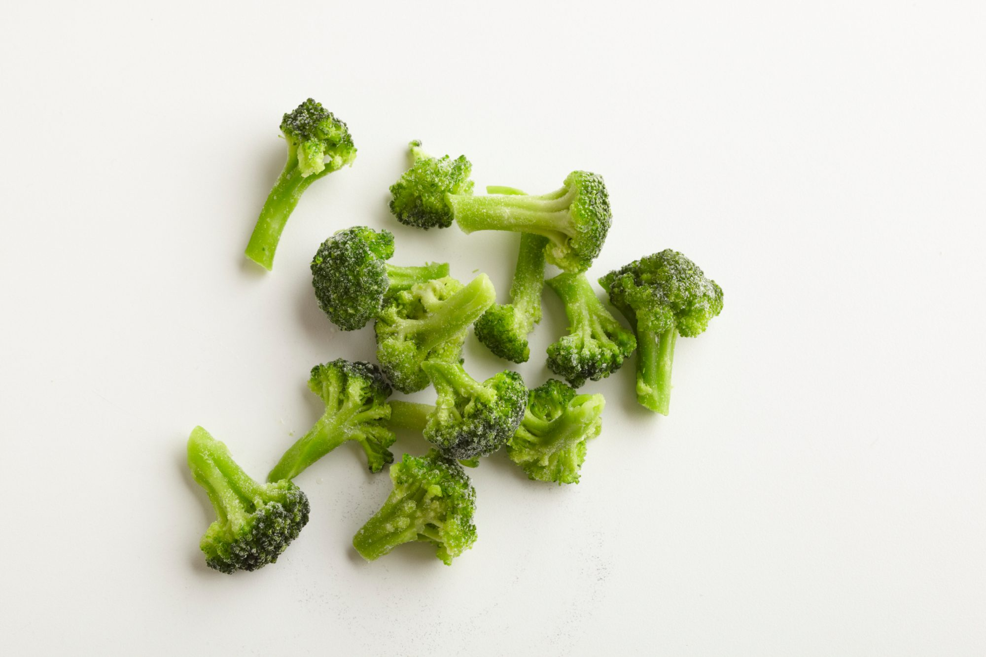 frozen broccoli on white background