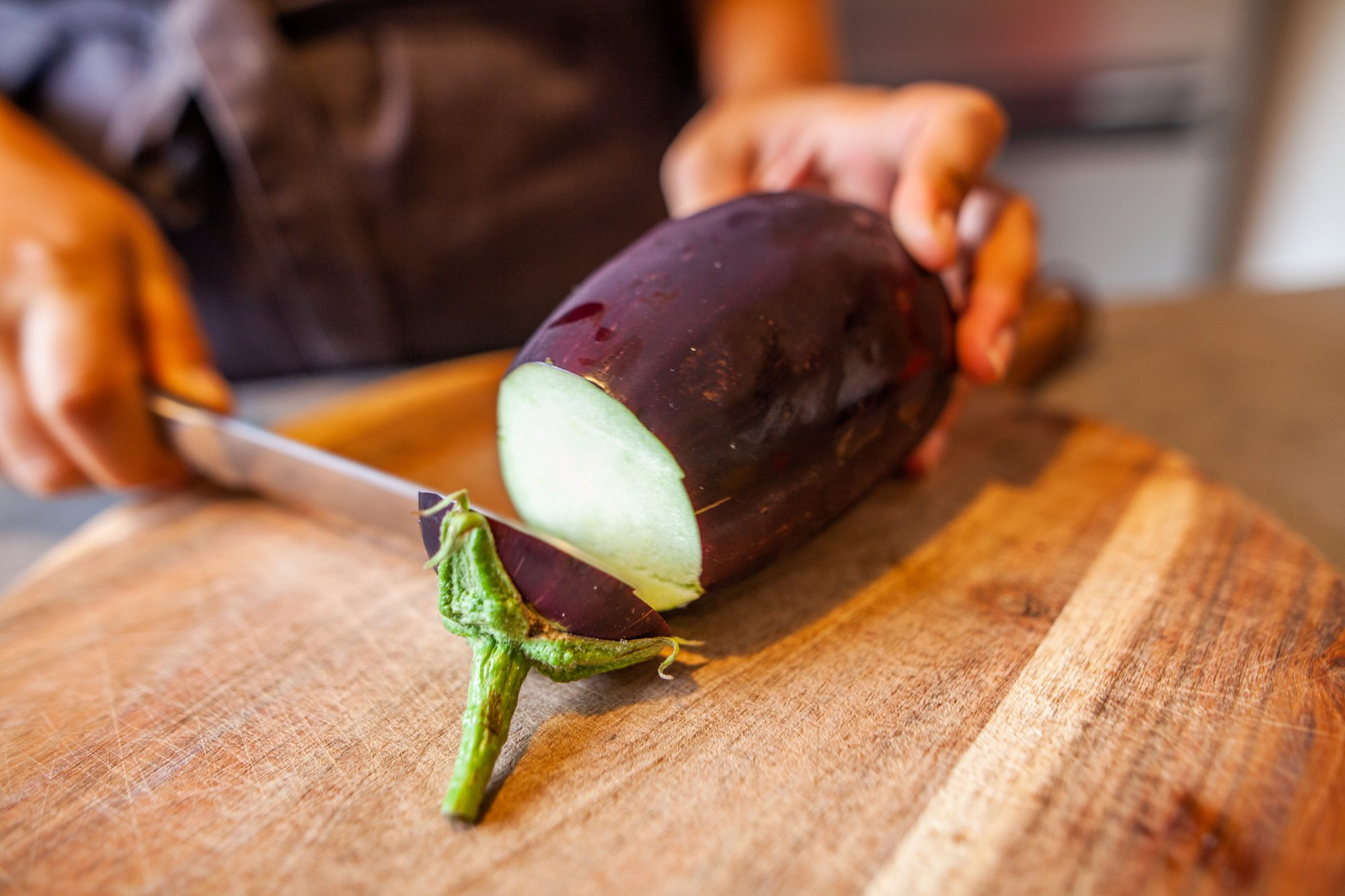 eggplant being sliced