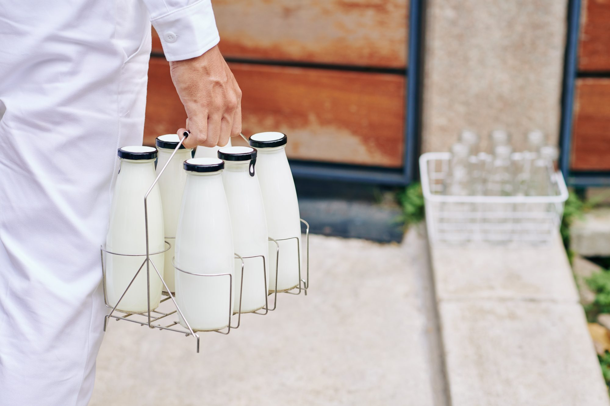 Delivery man carrying milk