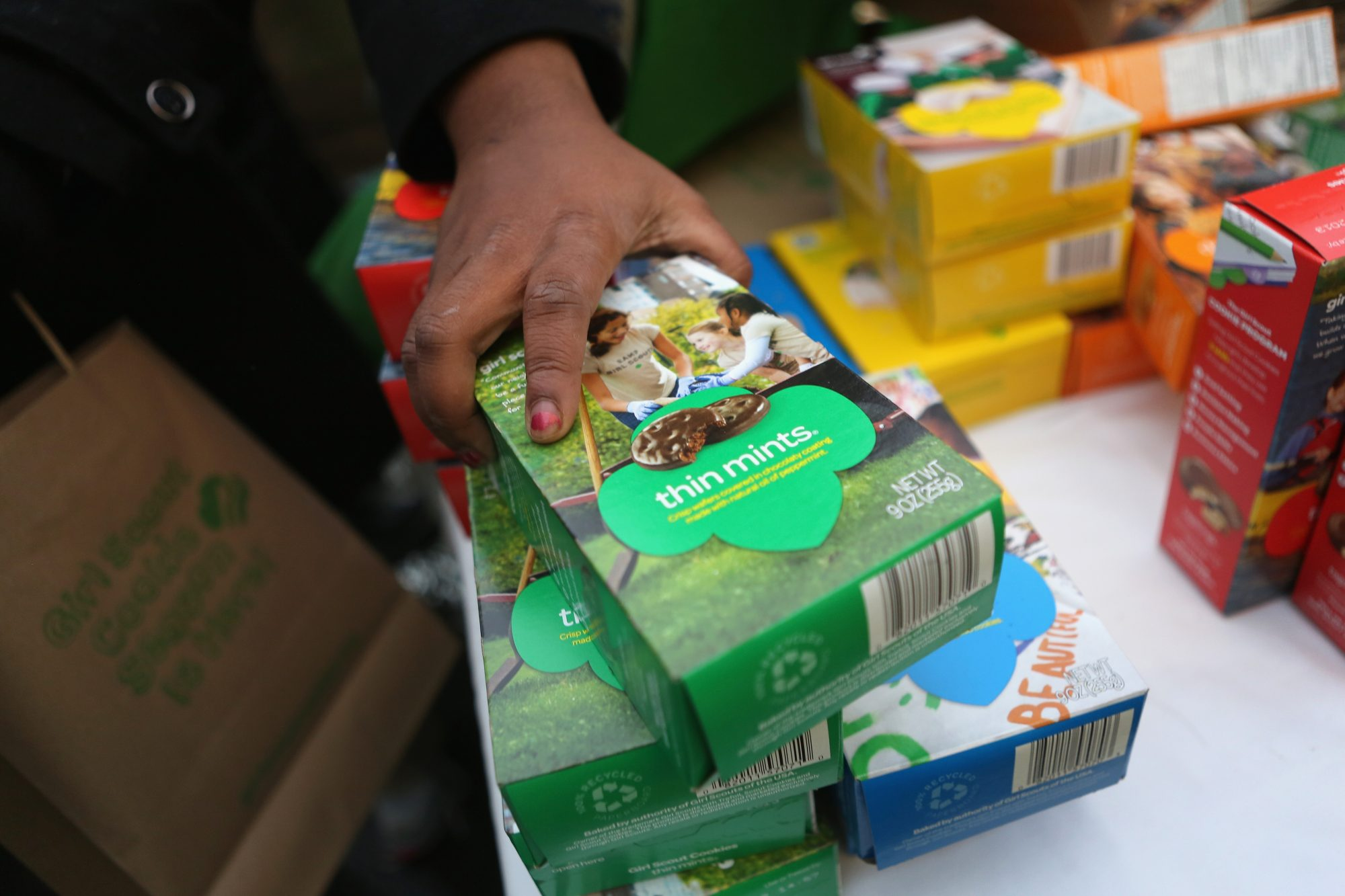 NEW YORK, NY - FEBRUARY 08: Girl Scouts sell cookies as a winter storm moves in on February 8, 2013 in New York City. The scouts did brisk business, setting up shop in locations around Midtown Manhattan on National Girl Scout Cookie Day. (Photo by John Moore/Getty Images)
