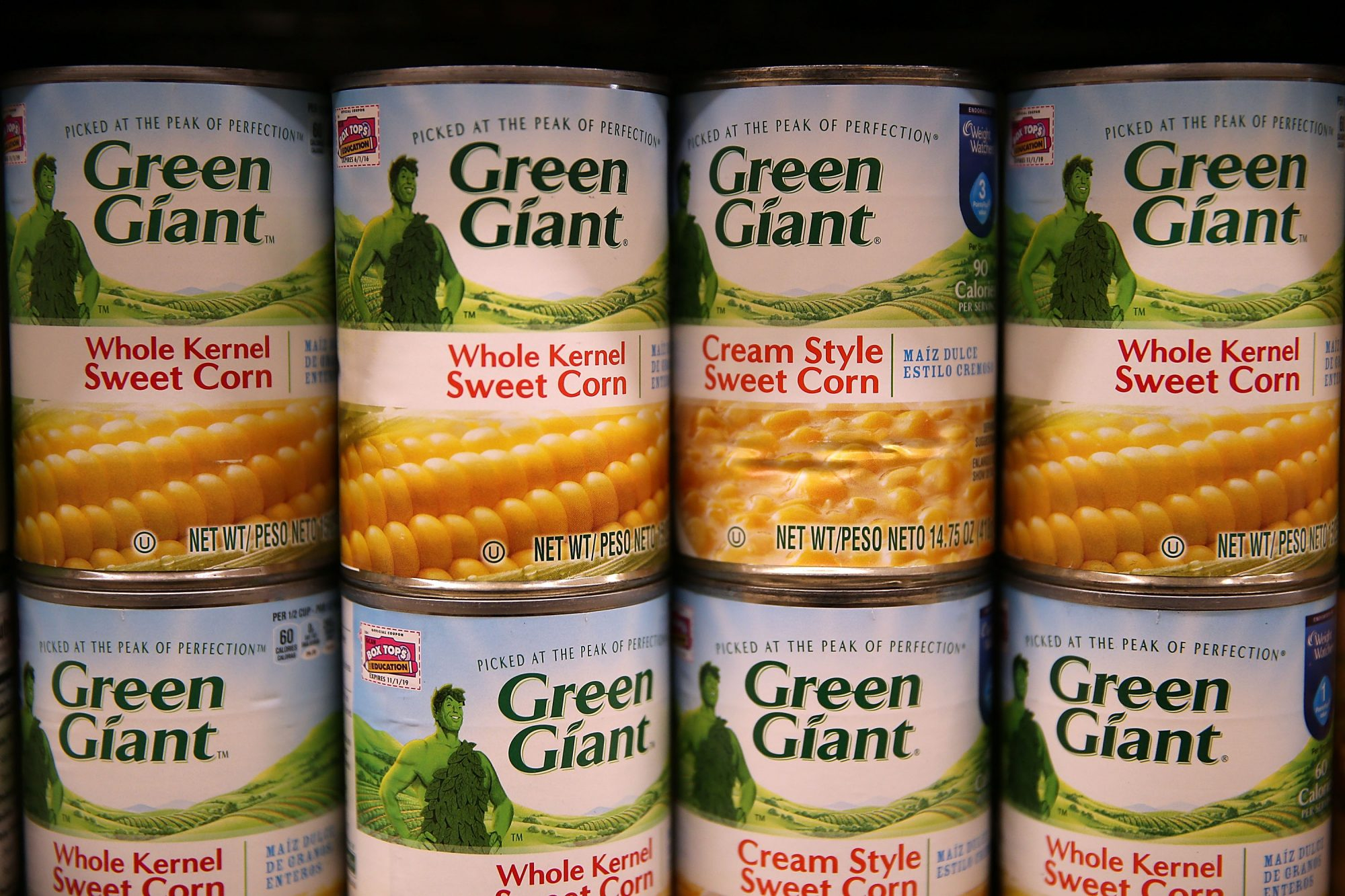 Canned sweet corn on a supermarket shelf
