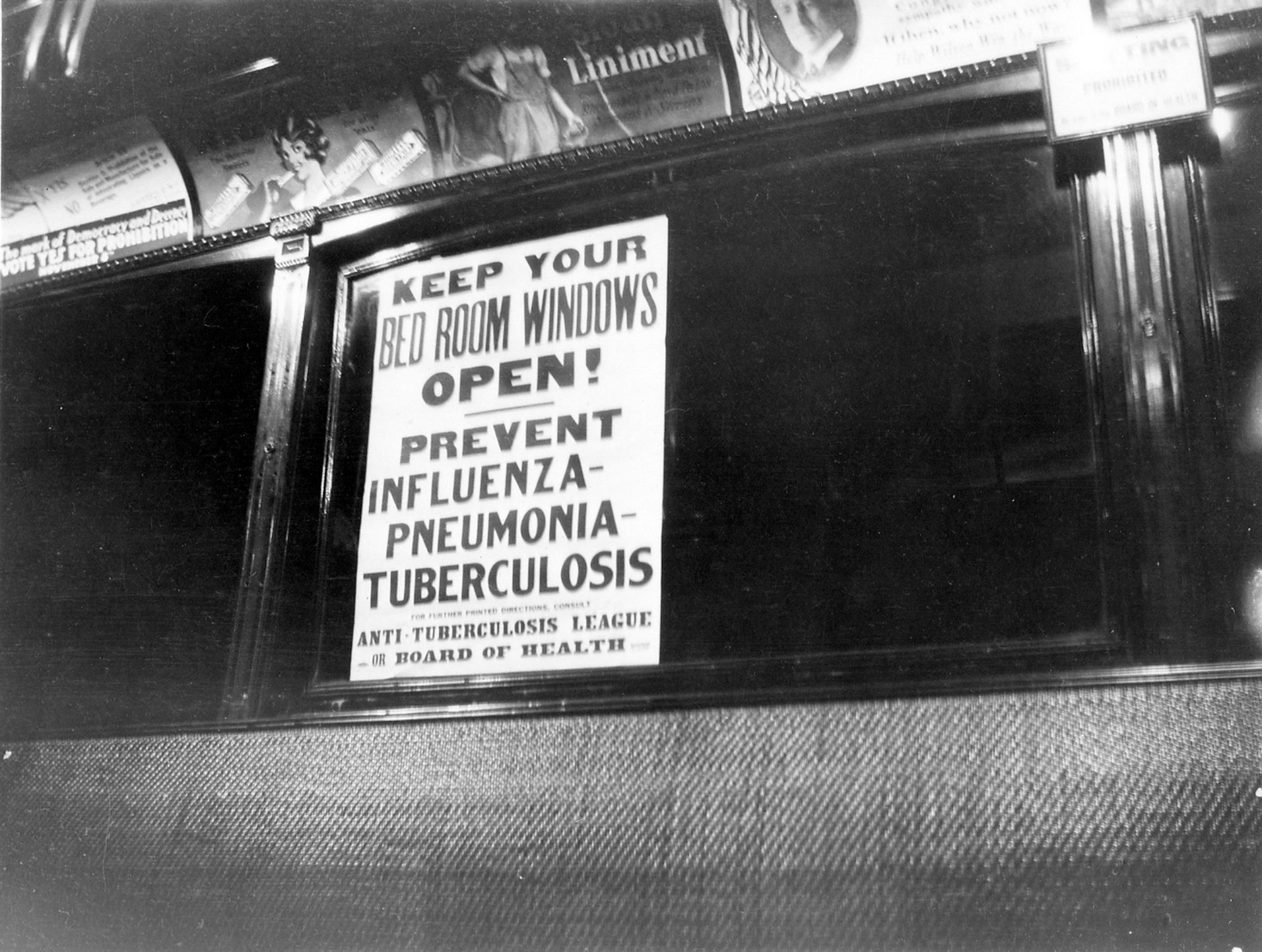 A post public health notice about the flu in a street car