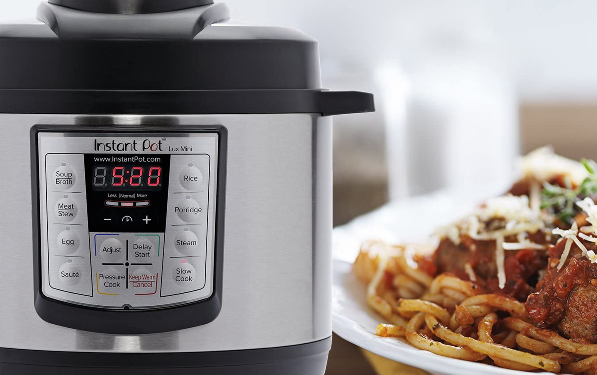 Instant pot with a bowl of spaghetti nearby